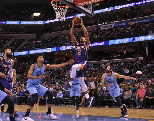 Oct 27, 2018; Memphis, TN, USA; Phoenix Suns guard Elie Okobo (2) shoots the ball over Memphis Grizzlies forward Ivan Rabb (10) during the first half at FedExForum. Mandatory Credit: Justin Ford-USA TODAY Sports