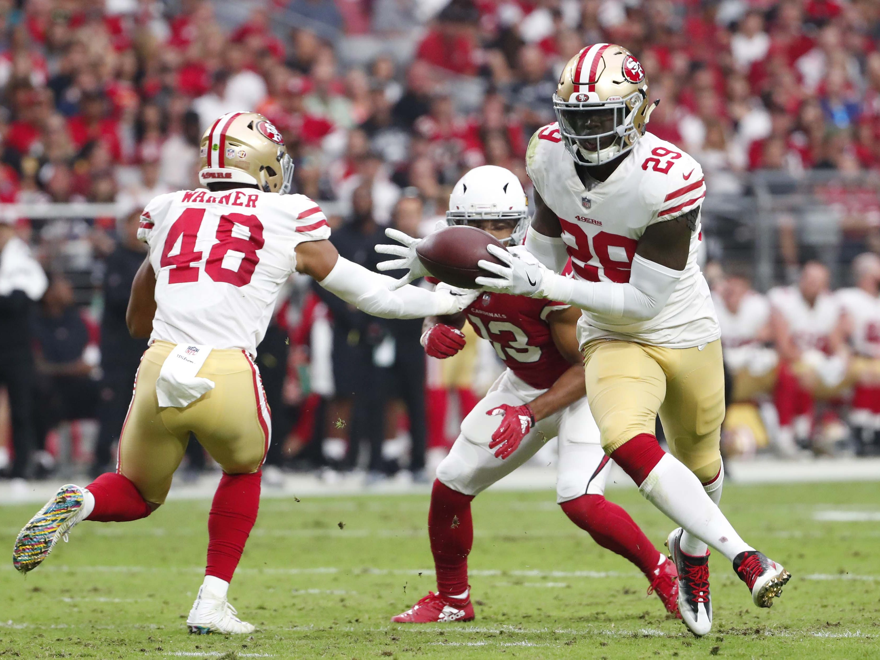 San Francisco 49ers strong safety Jaquiski Tartt (29) intercepts a pass against the Arizona Cardinals In the second quarter during NFL action against the San Francisco 49ers on Oct. 28 at State Farm Stadium.