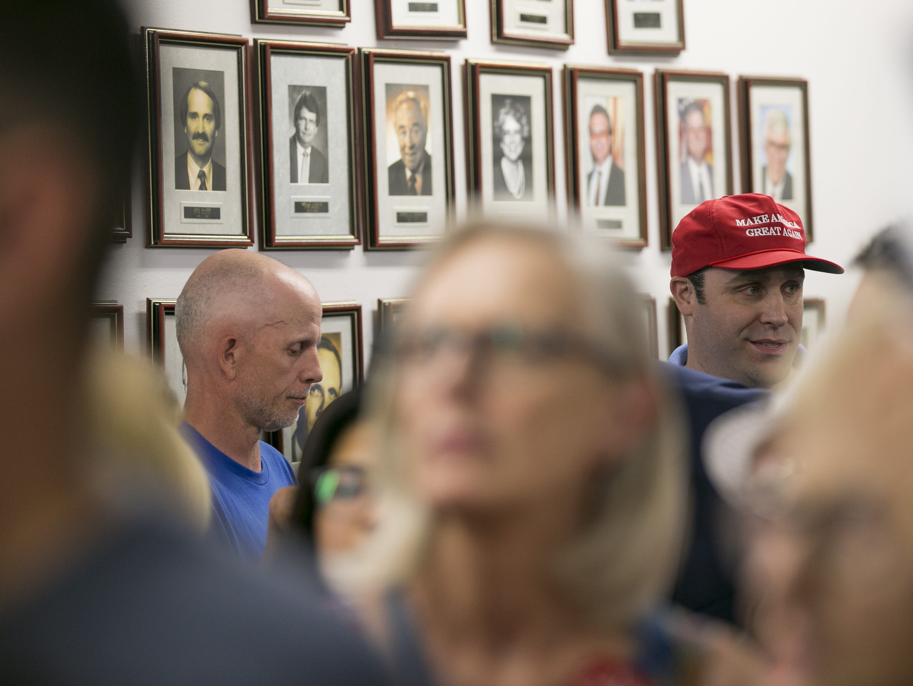 Republican supporters watch Sen. Lindsey Graham, R-S.C. as he speaks at the Arizona GOP headquarters in Phoenix, Ariz. on Oct. 27, 2018.
