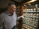 Don Carson, an owner and managing partner of Don and Charlie's, point to autographed baseballs from from Ted Williams, Babe Ruth and Mickey Mantle at Don & Charlie's in Scottsdale on Oct. 26, 2018. Don & Charlie's, a beloved Chicago-style steakhouse in Old Town Scottsdale covered from wall to wall in sports memorabilia, will be transformed into a new boutique hotel.