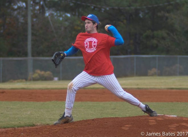 An Alternative Baseball league player pitches at the mound.