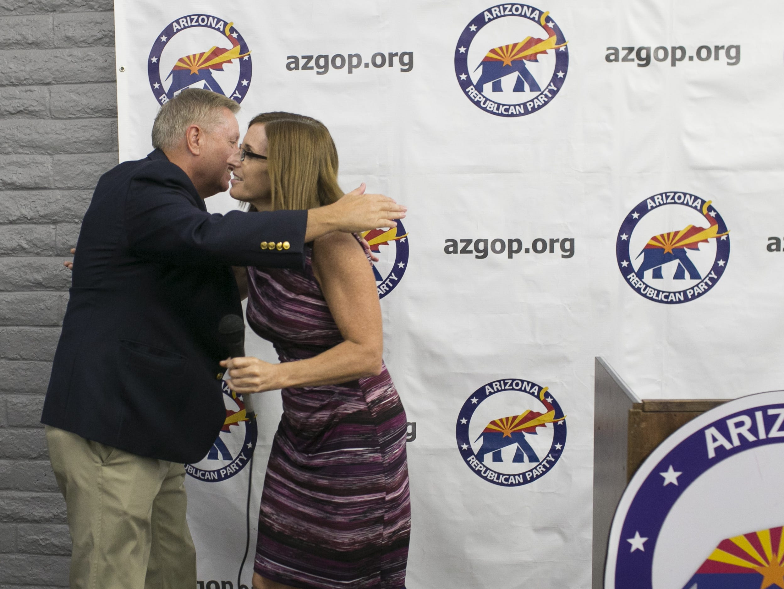 Sen. Lindsey Graham, R-S.C. hugs U.S. Senate candidate Martha McSally at the Arizona GOP headquarters in Phoenix, Ariz. on Oct. 27, 2018.