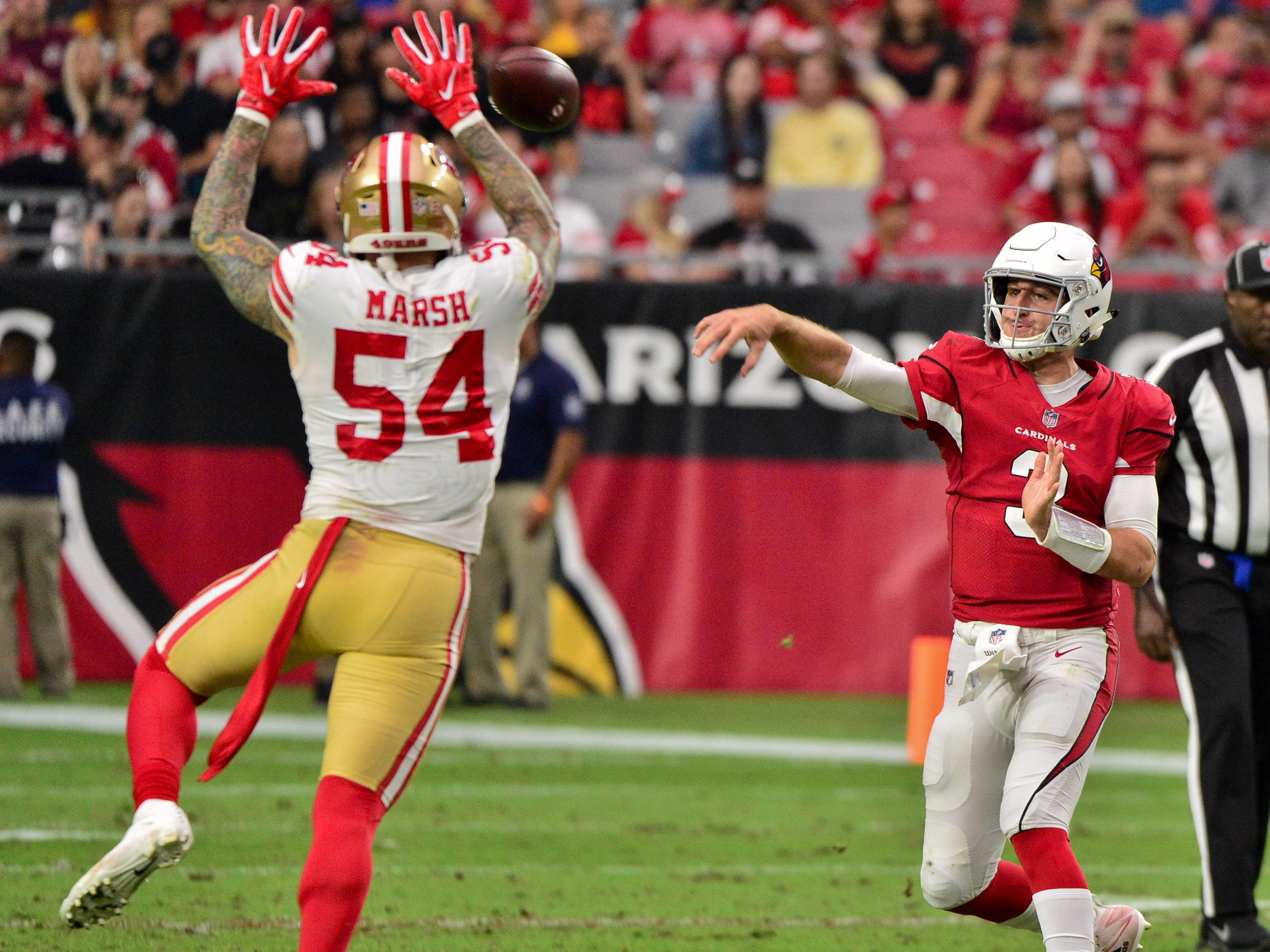 Oct 28, 2018; Glendale, AZ, USA; Arizona Cardinals quarterback Josh Rosen (3) throws as San Francisco 49ers defensive end Cassius Marsh (54) attepts the block during the first half at State Farm Stadium.