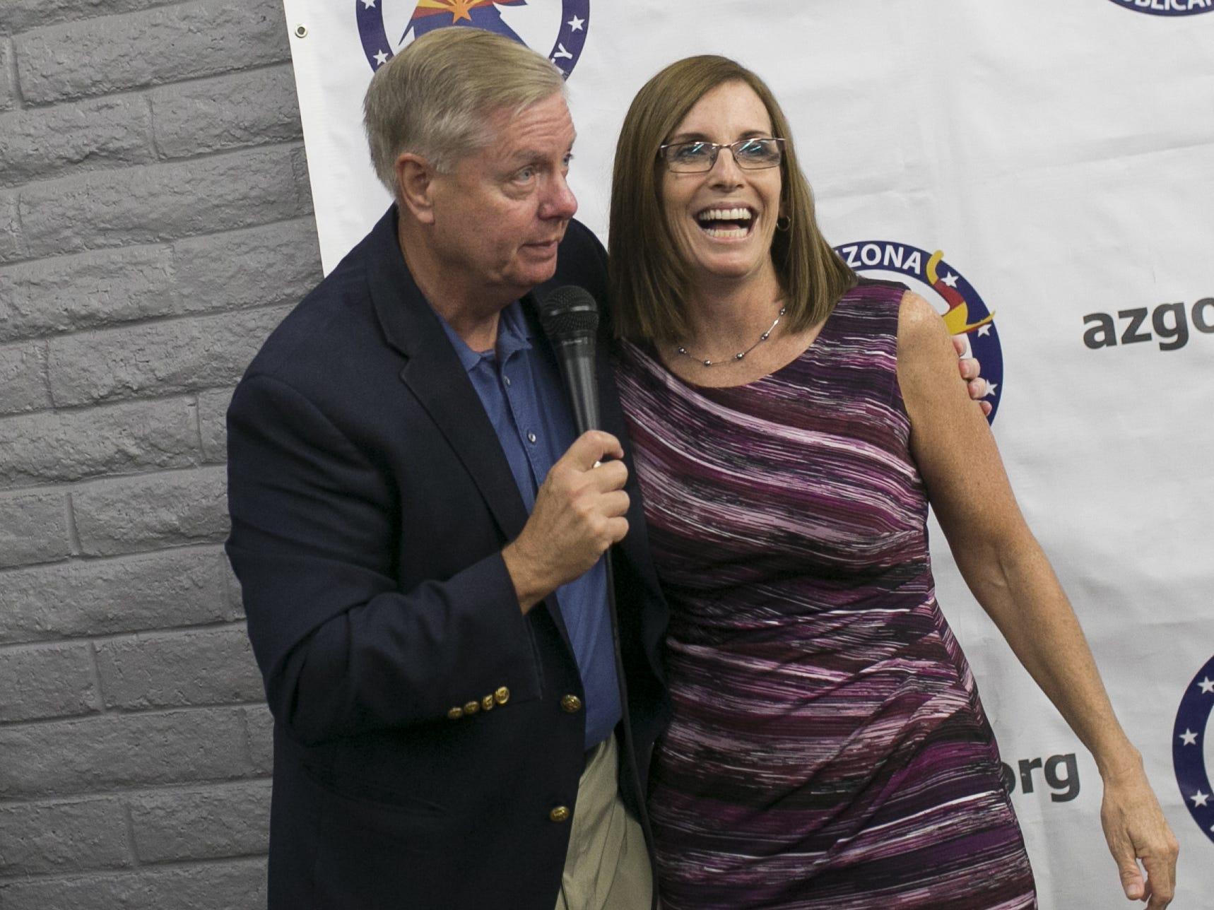 Sen. Lindsey Graham, R-S.C. (hugs U.S. Senate candidate Martha McSally at the Arizona GOP headquarters in Phoenix, Ariz. on Oct. 27, 2018.