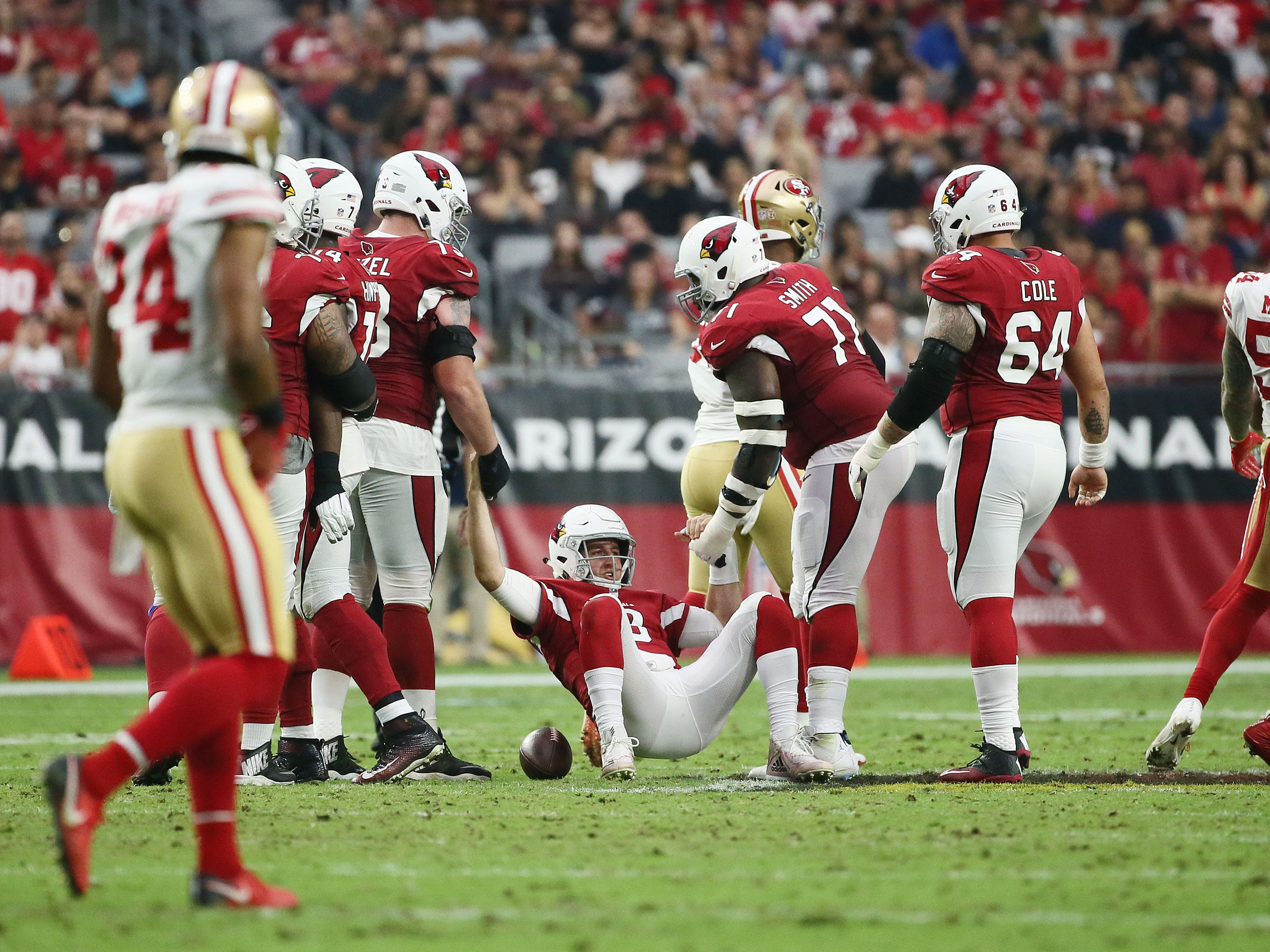 Arizona Cardinals quarterback Josh Rosen is helped off the turf after being sacked by the San Francisco 49ers in the first half during a game on Oct. 28 at State Farm Stadium.