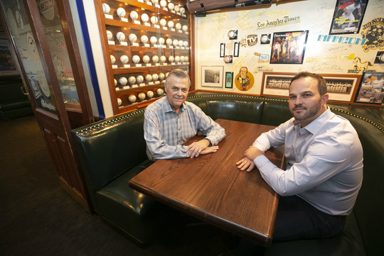 Don Carson, (left) an owner and managing partner of Don and Charlie's, and Tyler Kent, a hotel developer, sit at a table at the restaurant in Scottsdale on Oct. 26, 2018. Don & Charlie's, a beloved Chicago-style steakhouse in Old Town Scottsdale covered from wall to wall in sports memorabilia, will be transformed into a new boutique hotel, breaking ground next summer.