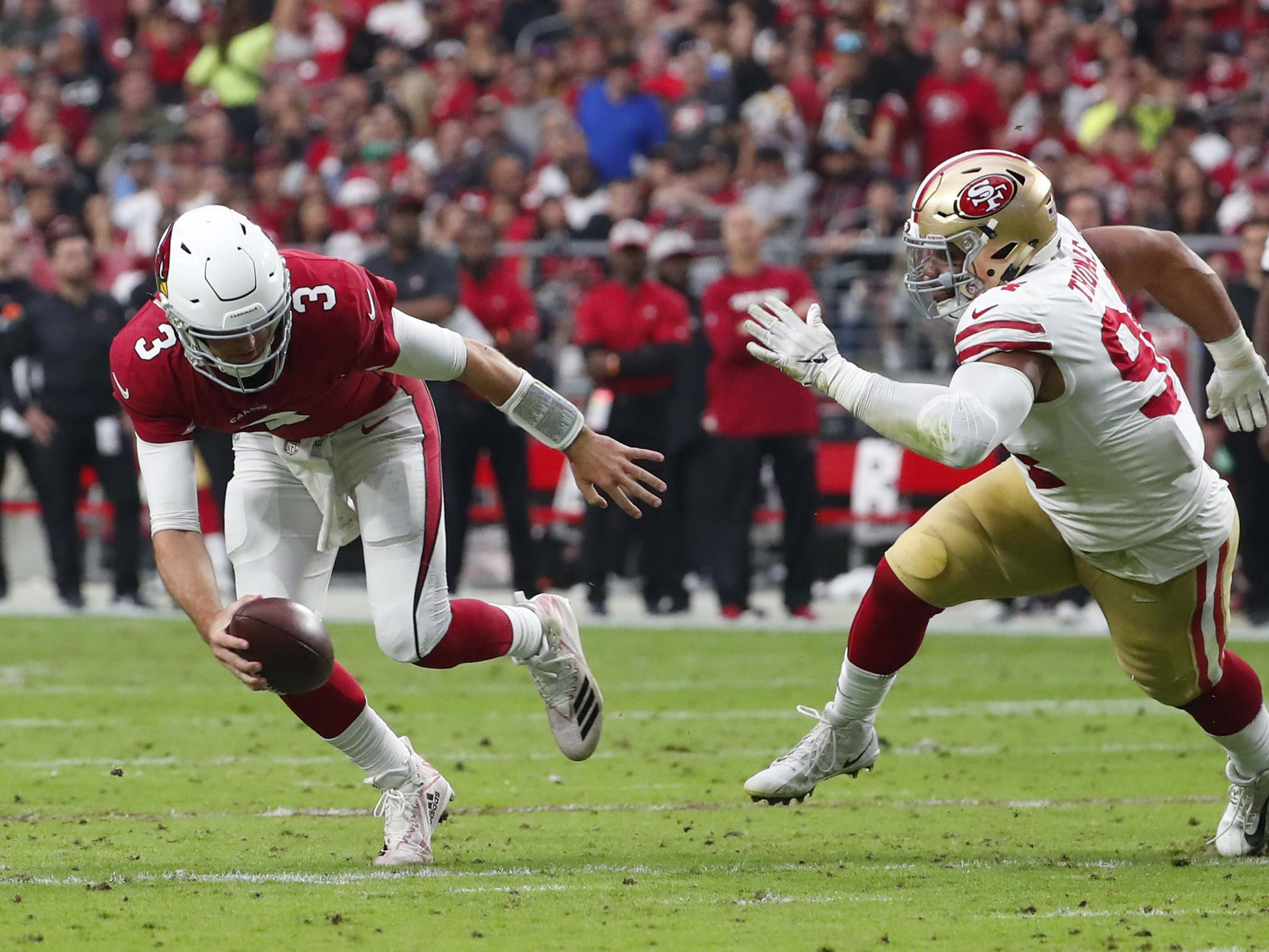 Arizona Cardinals quarterback Josh Rosen (3) scrambles away from San Francisco 49ers defensive end Solomon Thomas (94) in the second quarter during NFL action against the San Francisco 49ers on Oct. 28 at State Farm Stadium.