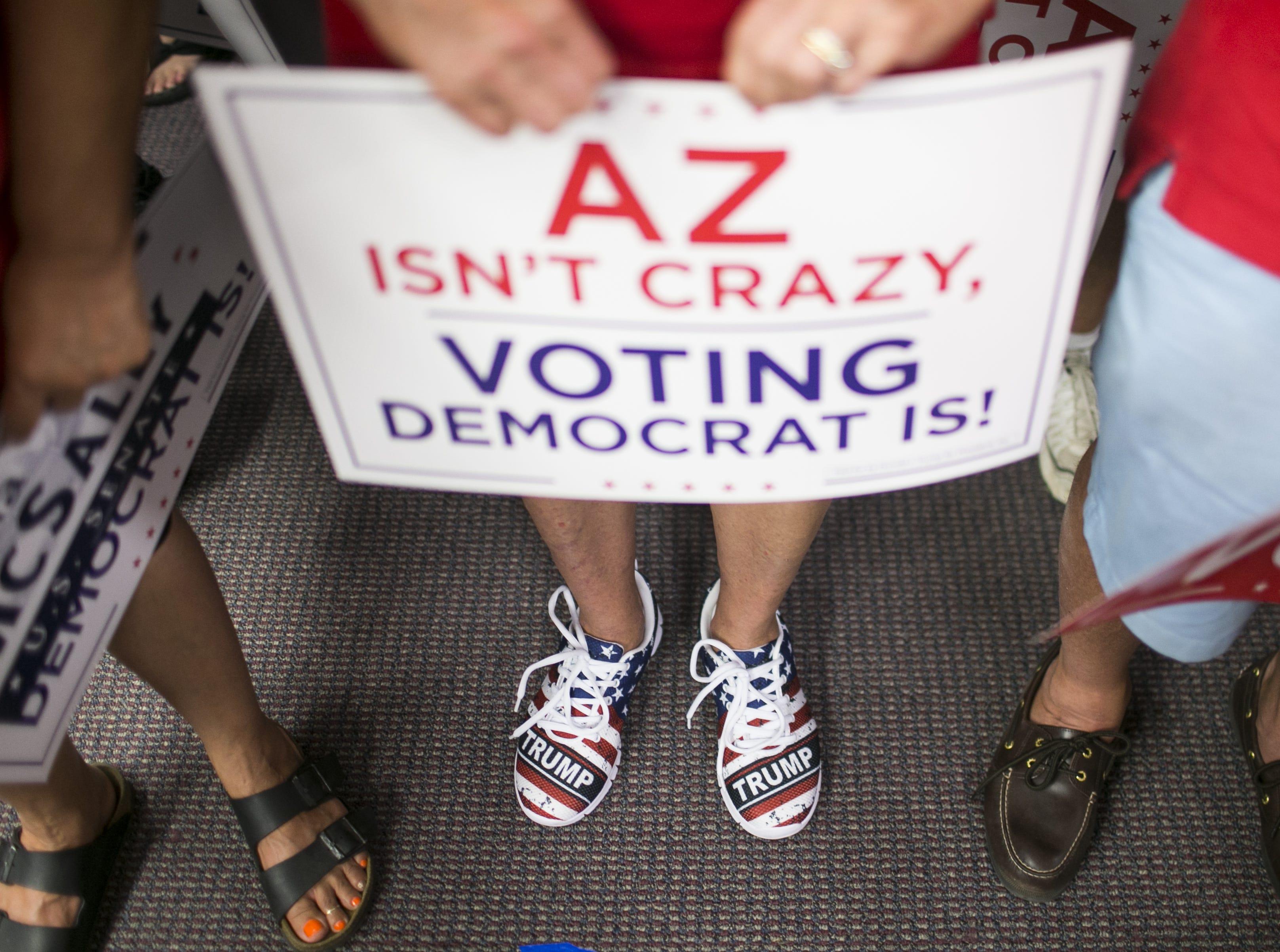 Republican supporters wait to see U.S. Senate candidate Martha McSally and Sen. Lindsey Graham, R-S.C. speak at the Arizona GOP headquarters in Phoenix, Ariz. on Oct. 27, 2018.