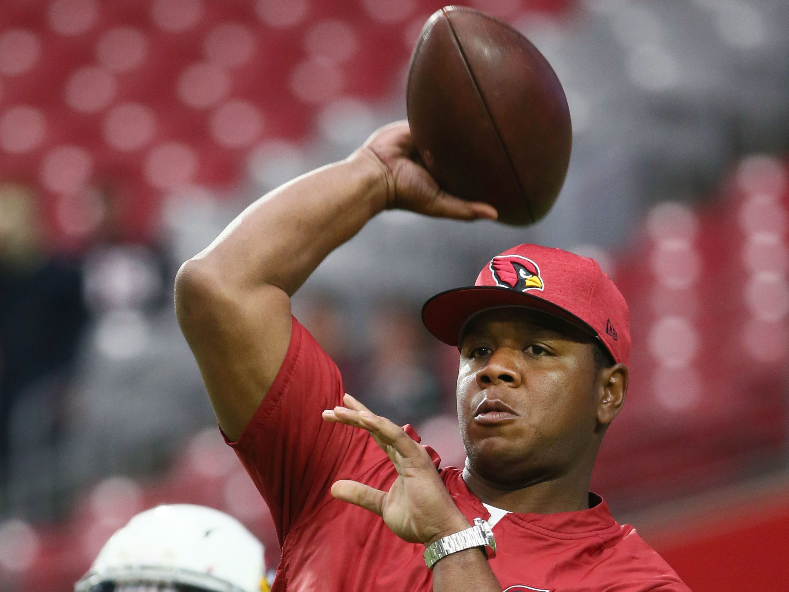Arizona Cardinals new offensive coordinator Byron Leftwich throws the ball before playing the San Francisco 49ers on Oct. 28 at State Farm Stadium.