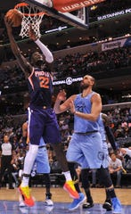 Oct 27, 2018; Memphis, TN, USA; Phoenix Suns center Deandre Ayton (22) shoots the ball over Memphis Grizzlies center Marc Gasol (33) during the first half at FedExForum. Mandatory Credit: Justin Ford-USA TODAY Sports