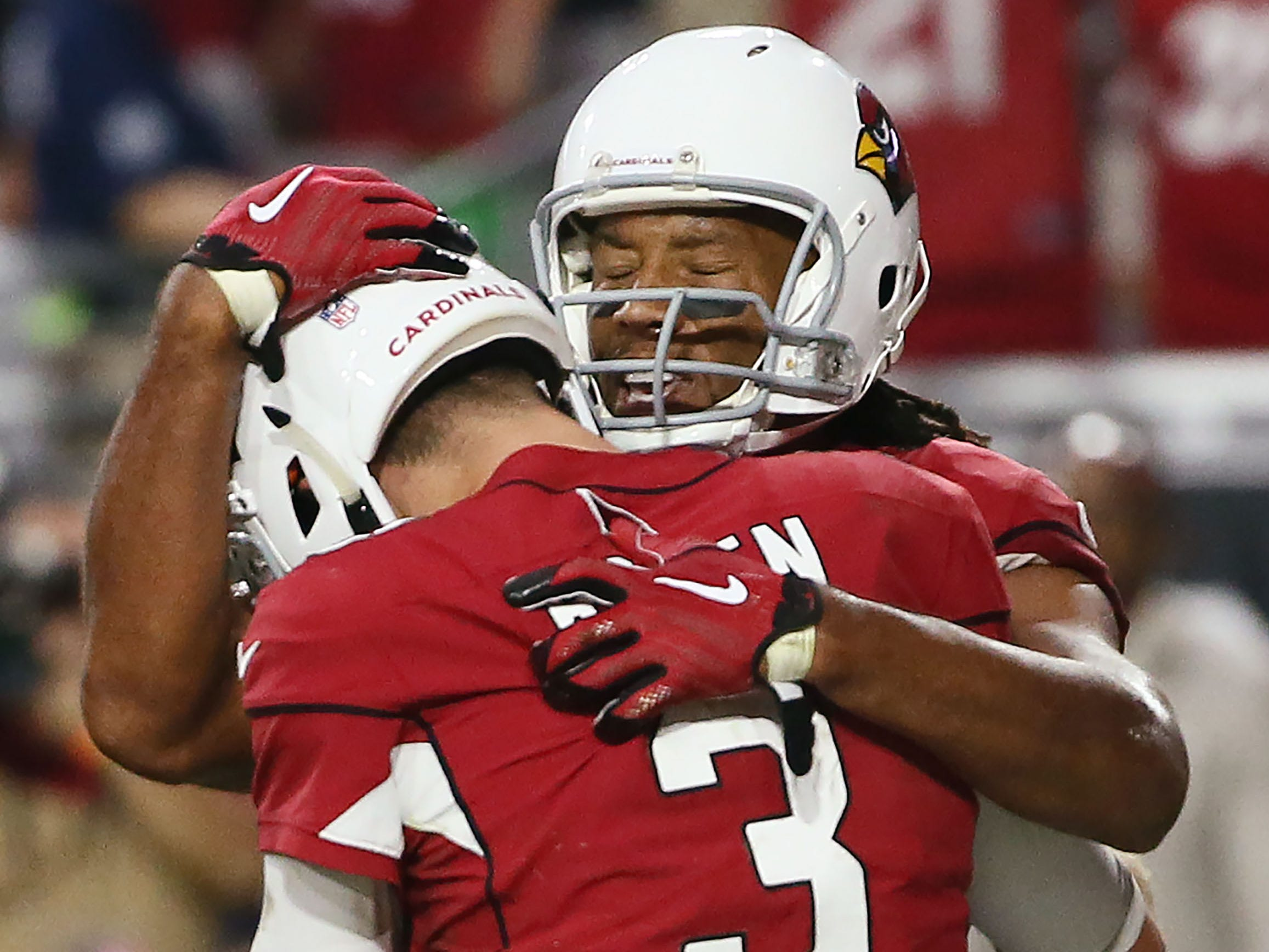 Arizona Cardinals Larry Fitzgerald hugs Josh Rosen after throwing the game winning touchdown against the San Francisco 49ers in the fourth quarter during a game on Oct. 28 at State Farm Stadium.