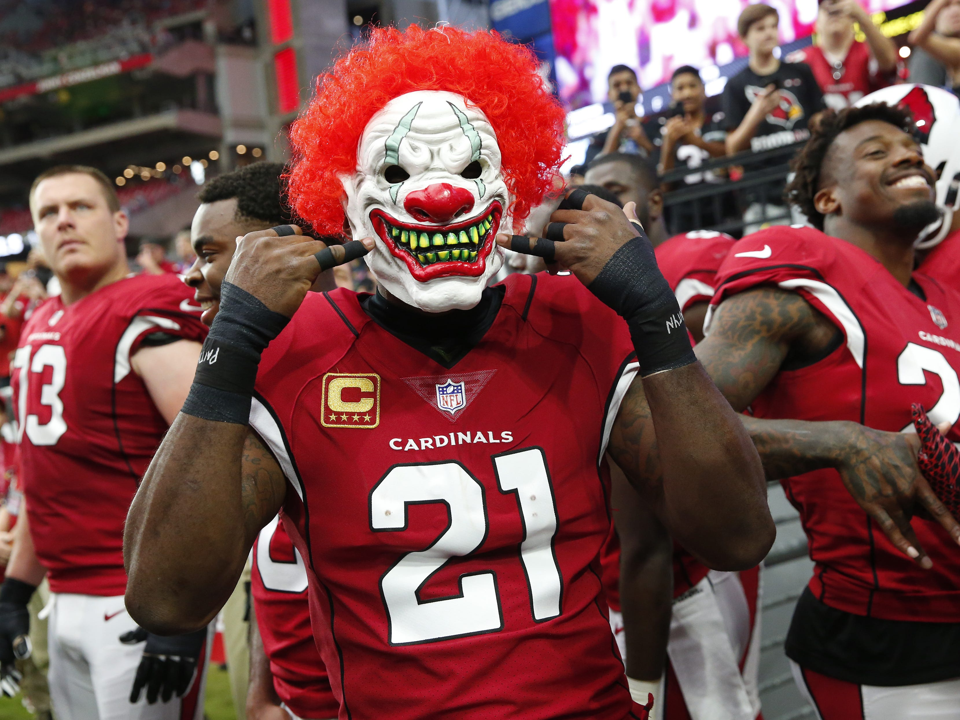 Arizona Cardinals cornerback Patrick Peterson (21) wears a mask before NFL action against the San Francisco 49ers on Oct. 28 at State Farm Stadium.