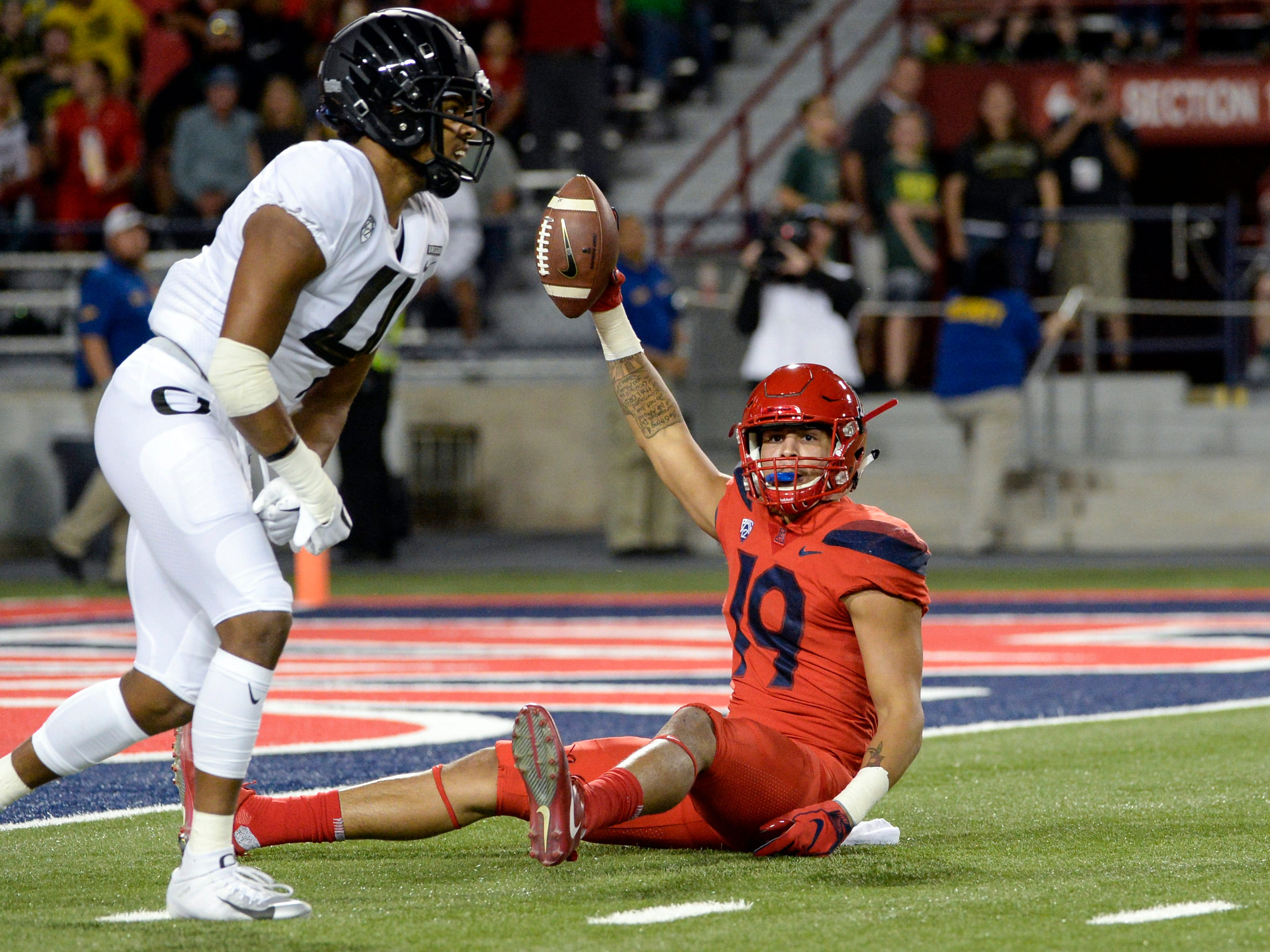 Oct 27, 2018; Tucson, AZ, USA; Arizona Wildcats wide receiver Shawn Poindexter (19) reacts to a call next to Oregon Ducks cornerback Thomas Graham Jr. (4) during the first half at Arizona Stadium. Mandatory Credit: Casey Sapio-USA TODAY Sports