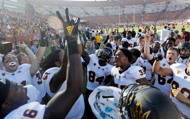 Arizona State players celebrate after a 38-35 win over Southern California during an NCAA college football game Saturday, Oct. 27, 2018, in Los Angeles.