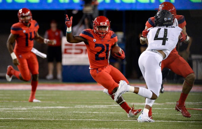 Oct 27, 2018; Tucson, AZ, USA; Arizona Wildcats running back J.J. Taylor (21) runs the ball against the Oregon Ducks during the first half at Arizona Stadium. Mandatory Credit: Casey Sapio-USA TODAY Sports