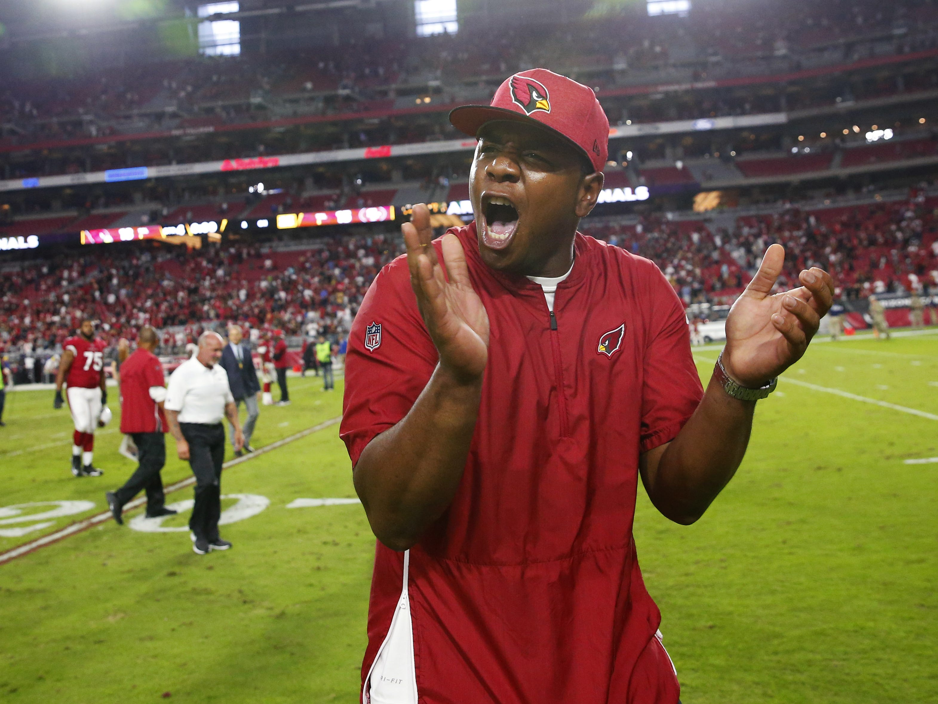 Arizona Cardinals offensive coordinator Byron Leftwich celebrates after an 18-15 come-from-behind win against the San Francisco 49ers on Oct. 28 at State Farm Stadium.