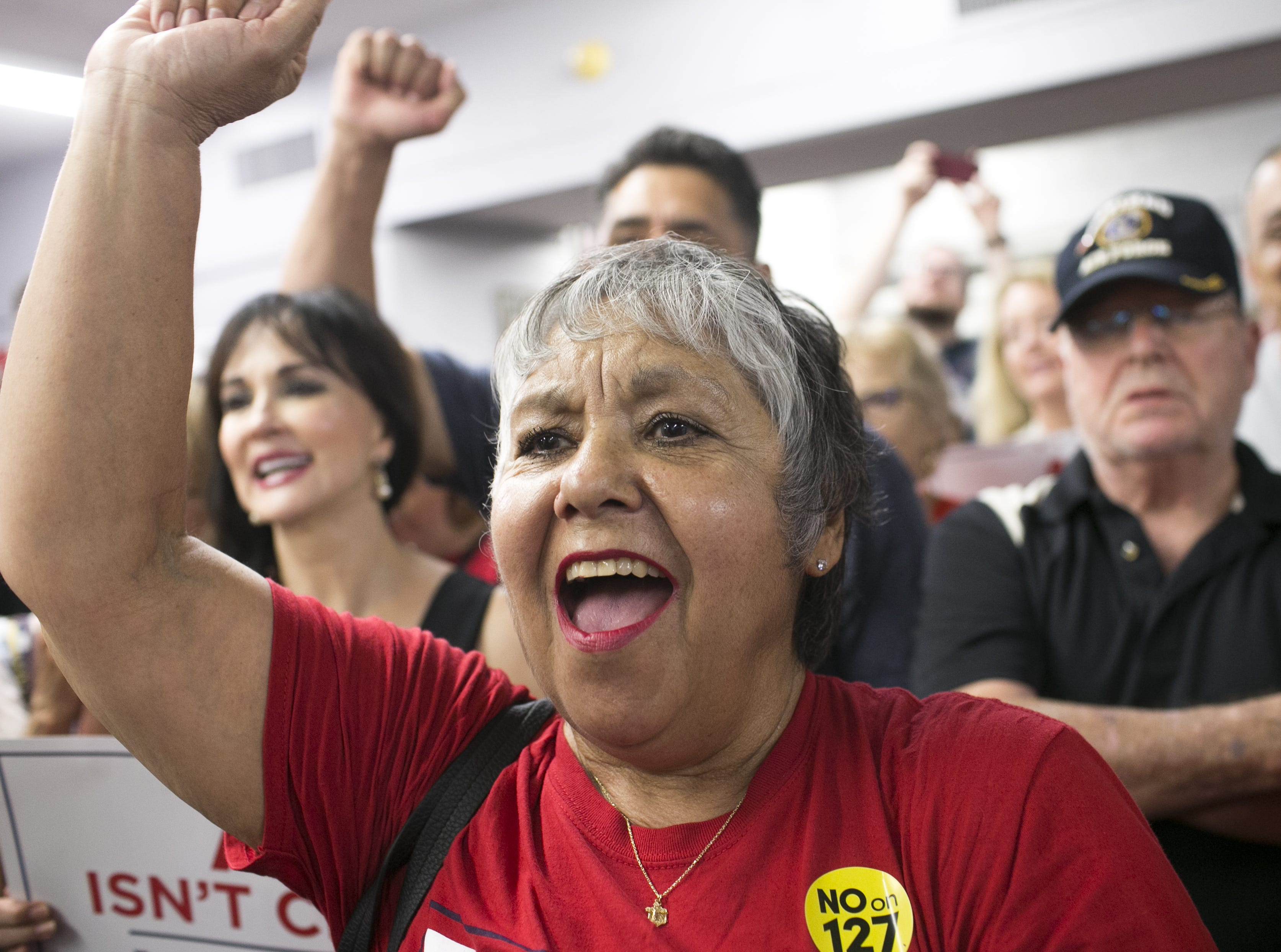 Republican supporters cheer to Sen. Lindsey Graham, R-S.C. as he speaks at the Arizona GOP headquarters in Phoenix, Ariz. on Oct. 27, 2018.