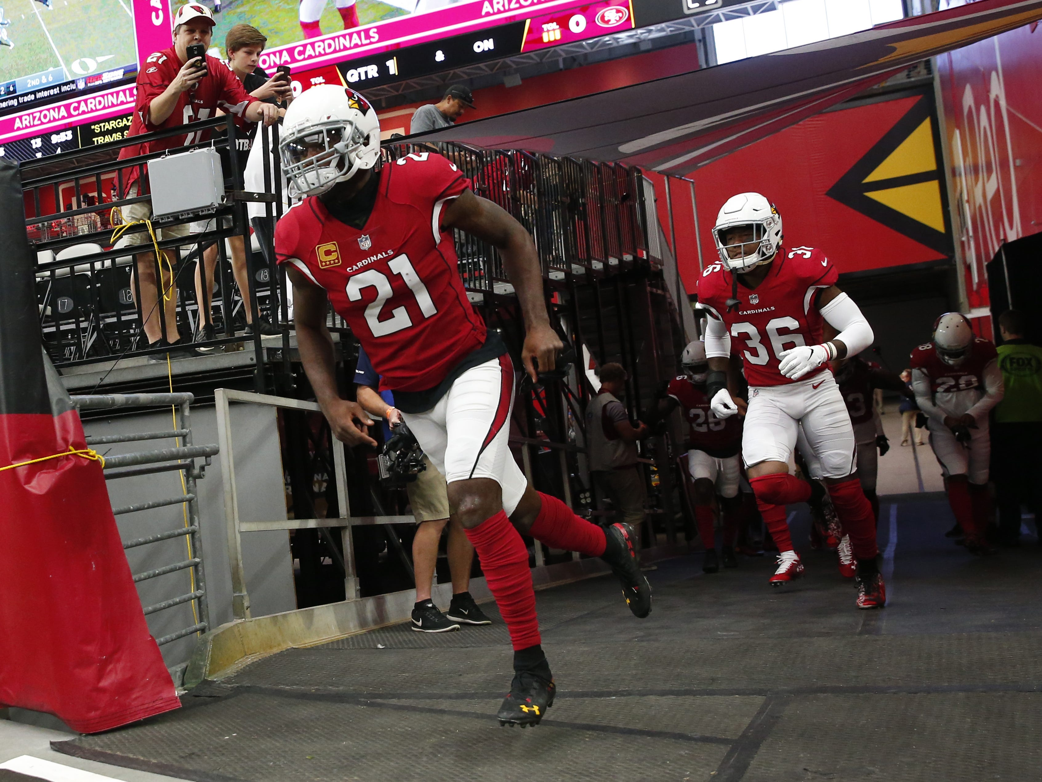 Arizona Cardinals cornerback Patrick Peterson (21) runs onto the field for warm ups before NFL action against the San Francisco 49ers on Oct. 28 at State Farm Stadium.