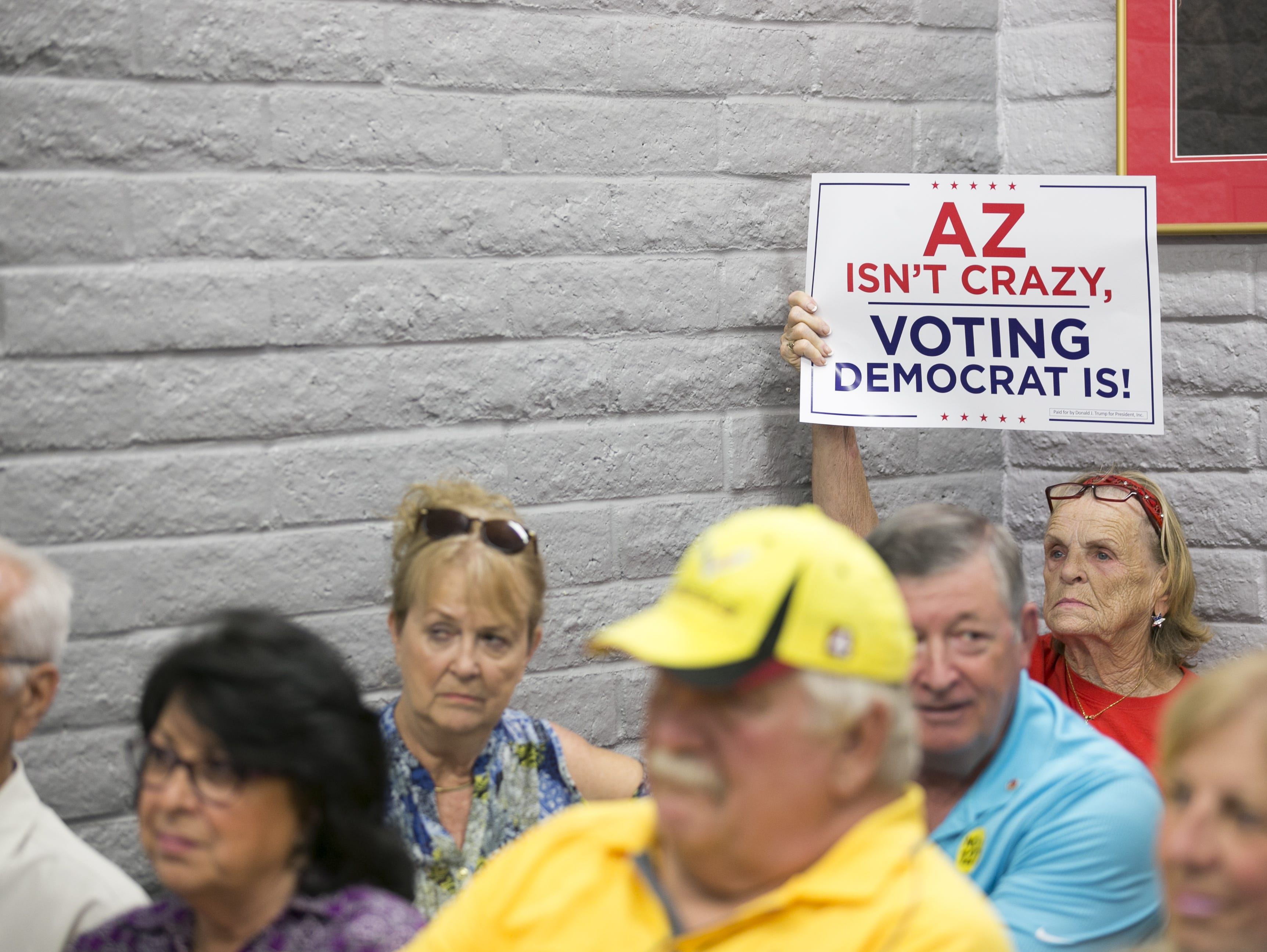 Republican supporters watch Sen. Lindsey Graham, R-S.C. as he speaks at the Arizona GOP headquarters in Phoenix, Ariz. on Oct. 27, 2018.