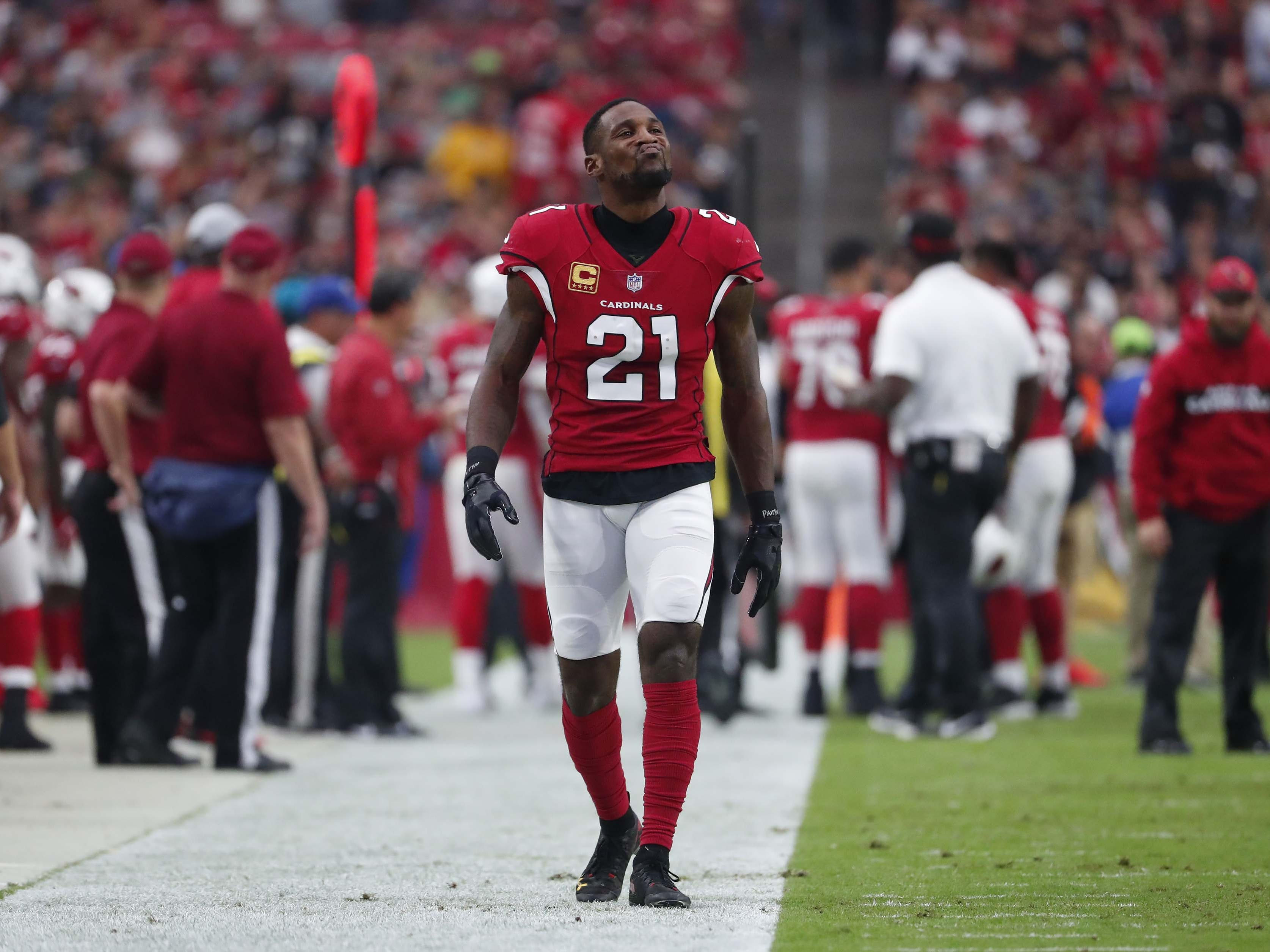 Arizona Cardinals cornerback Patrick Peterson (21) walks on the sidelines dung a break against the San Francisco 49ers during NFL action against the San Francisco 49ers on Oct. 28 at State Farm Stadium.