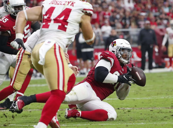 Arizona Cardinals defensive tackle Robert Nkemdiche (90) tries to intercept a pass against the San Francisco 49ers In the second quarter during NFL action against the San Francisco 49ers on Oct. 28 at State Farm Stadium.