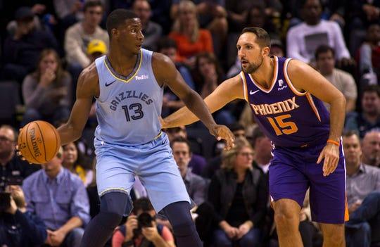 Oct 27, 2018; Memphis, TN, USA; Memphis Grizzlies forward Jaren Jackson Jr. (13) handles the ball against Phoenix Suns forward Ryan Anderson (15) during the first half at FedExForum. Mandatory Credit: Justin Ford-USA TODAY Sports
