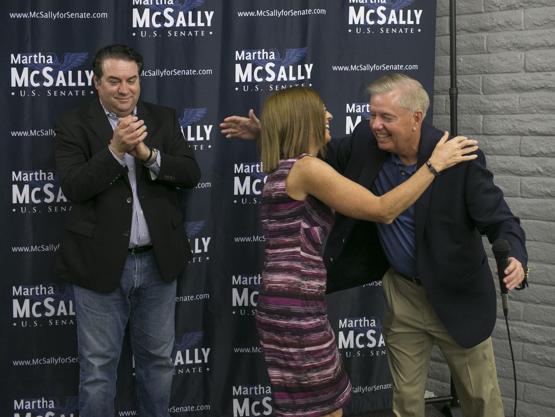 Sen. Lindsey Graham, R-S.C. (right) hugs U.S. Senate candidate Martha McSally at the Arizona GOP headquarters in Phoenix, Ariz. on Oct. 27, 2018.