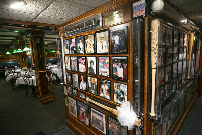 Sports memorabilia on the walls at Don & Charlie's in Scottsdale on Oct. 26, 2018. Don & Charlie's, a beloved Chicago-style steakhouse in Old Town Scottsdale covered from wall to wall in sports memorabilia, will be transformed into a new boutique hotel, breaking ground next summer.