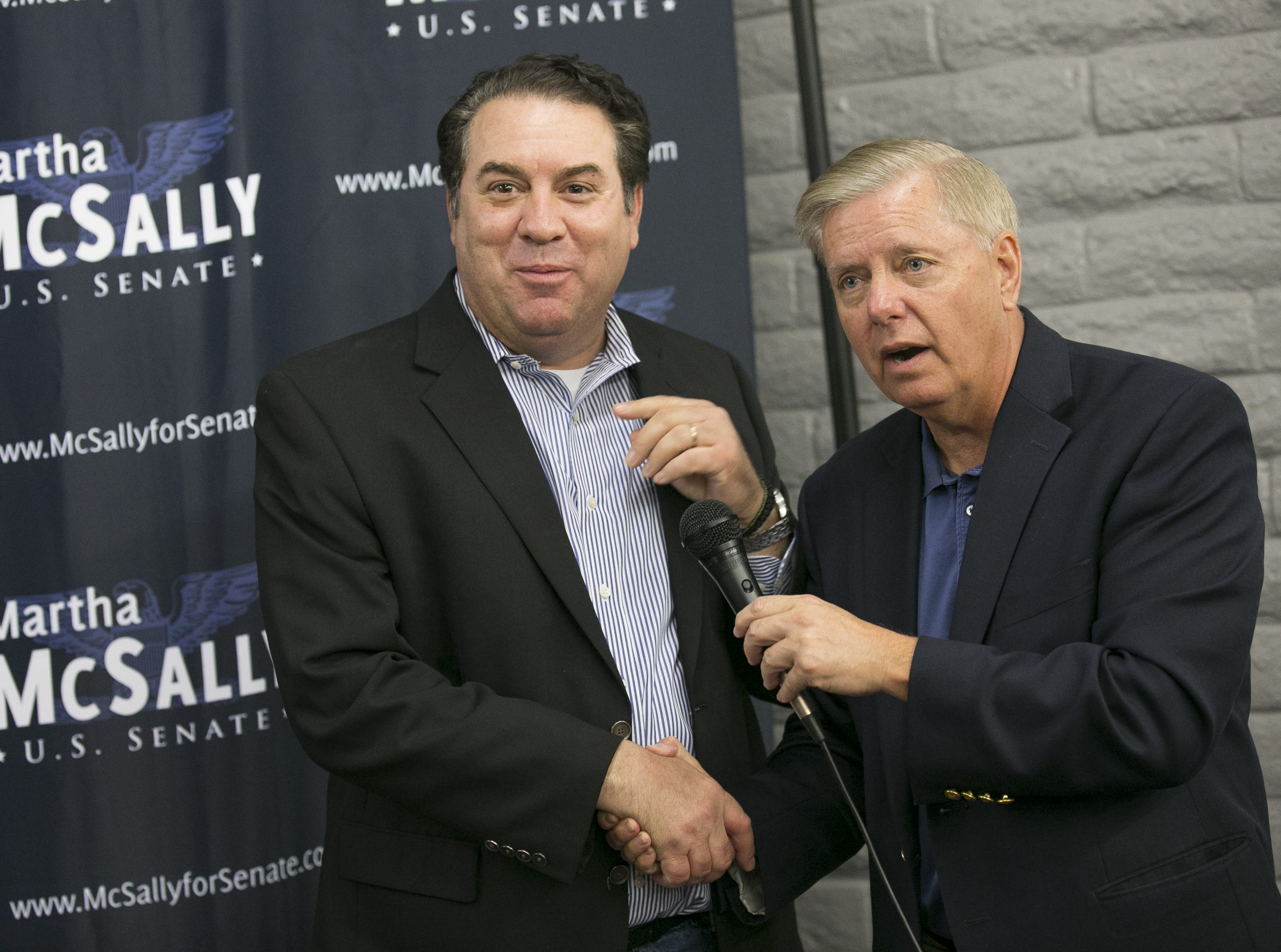 Attorney general Mark Brnovich (left) shakes hands with Sen. Lindsey Graham, R-S.C. (right) at the Arizona GOP headquarters in Phoenix, Ariz. on Oct. 27, 2018.