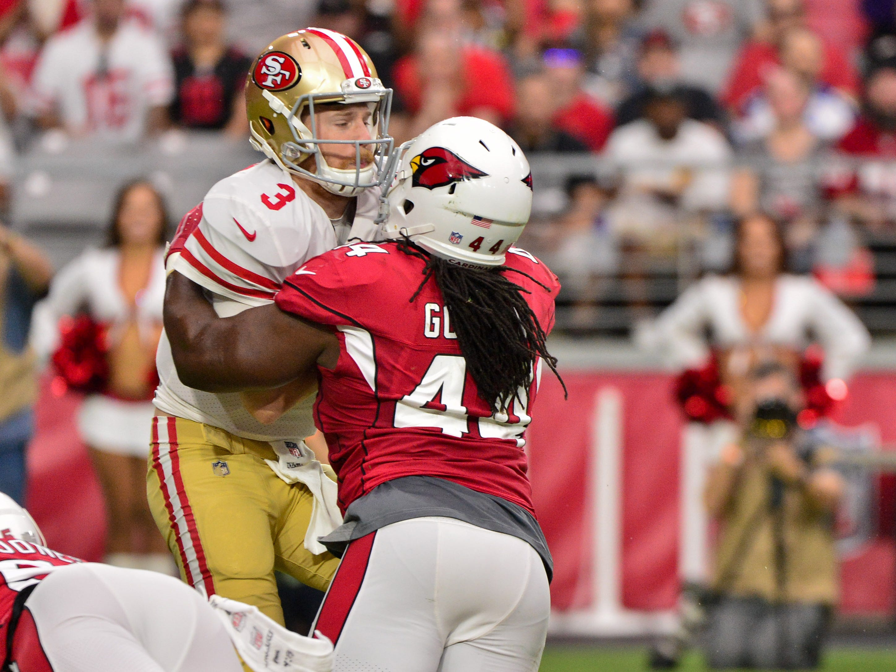 Oct 28, 2018; Glendale, AZ, USA; Arizona Cardinals defensive end Markus Golden (44) sacks San Francisco 49ers quarterback C.J. Beathard (3) during the first half at State Farm Stadium.