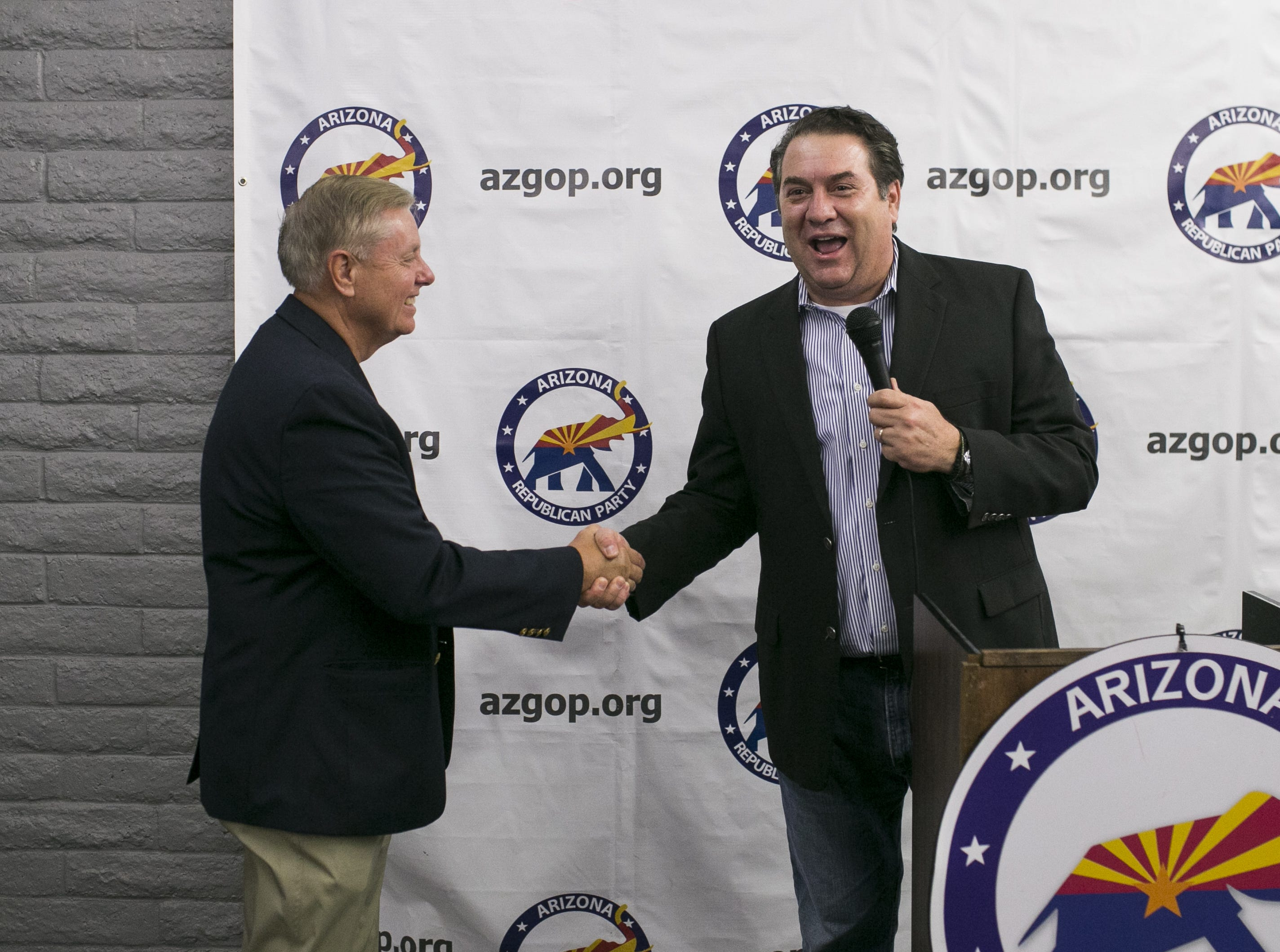 Attorney general Mark Brnovich (right) shakes hands with Sen. Lindsey Graham, R-S.C. (left) at the Arizona GOP headquarters in Phoenix, Ariz. on Oct. 27, 2018.