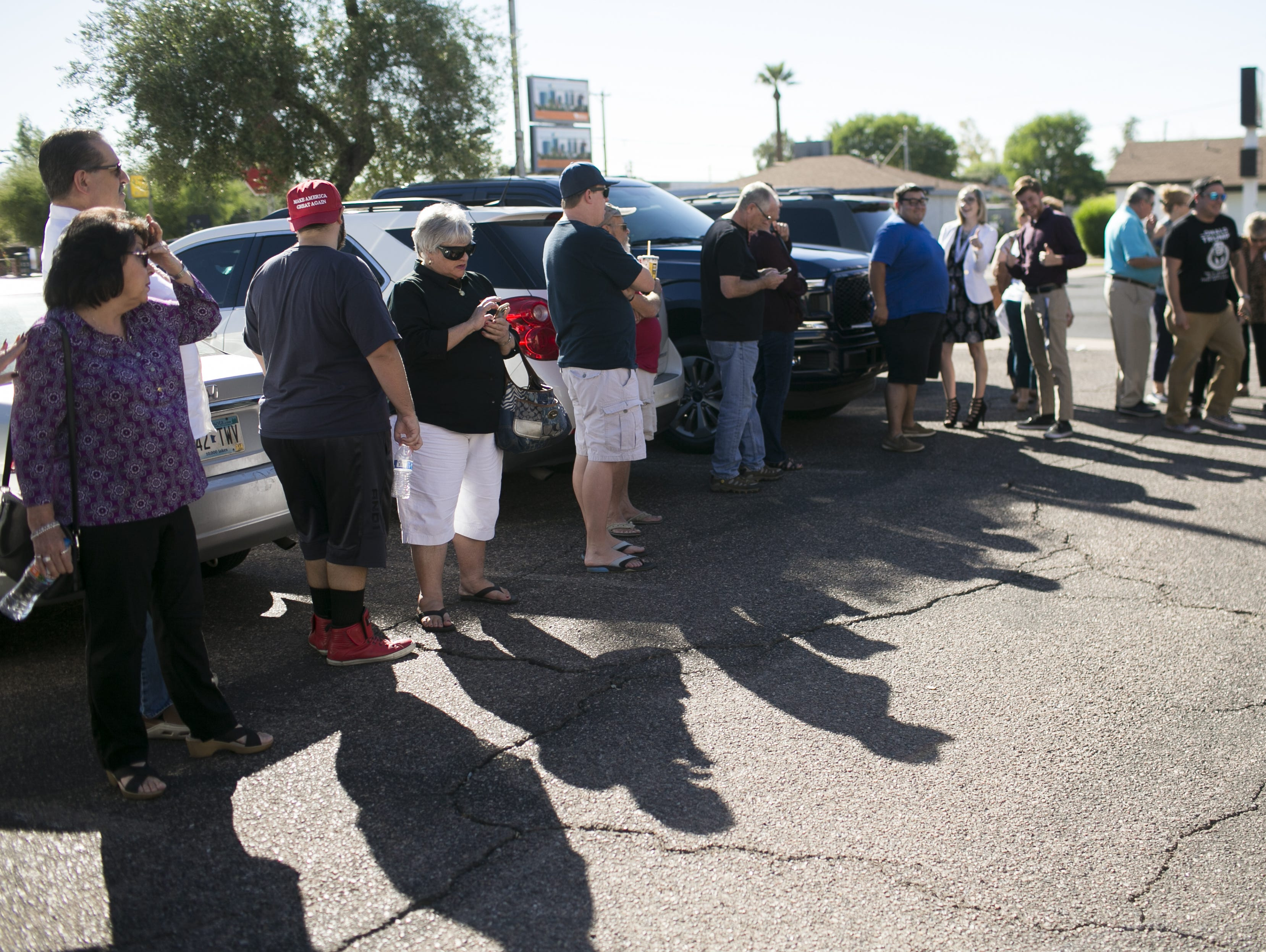 Republican supporters stand in line to see U.S. Senate candidate Martha McSally and Sen. Lindsey Graham, R-S.C. speak at the Arizona GOP headquarters in Phoenix, Ariz. on Oct. 27, 2018.