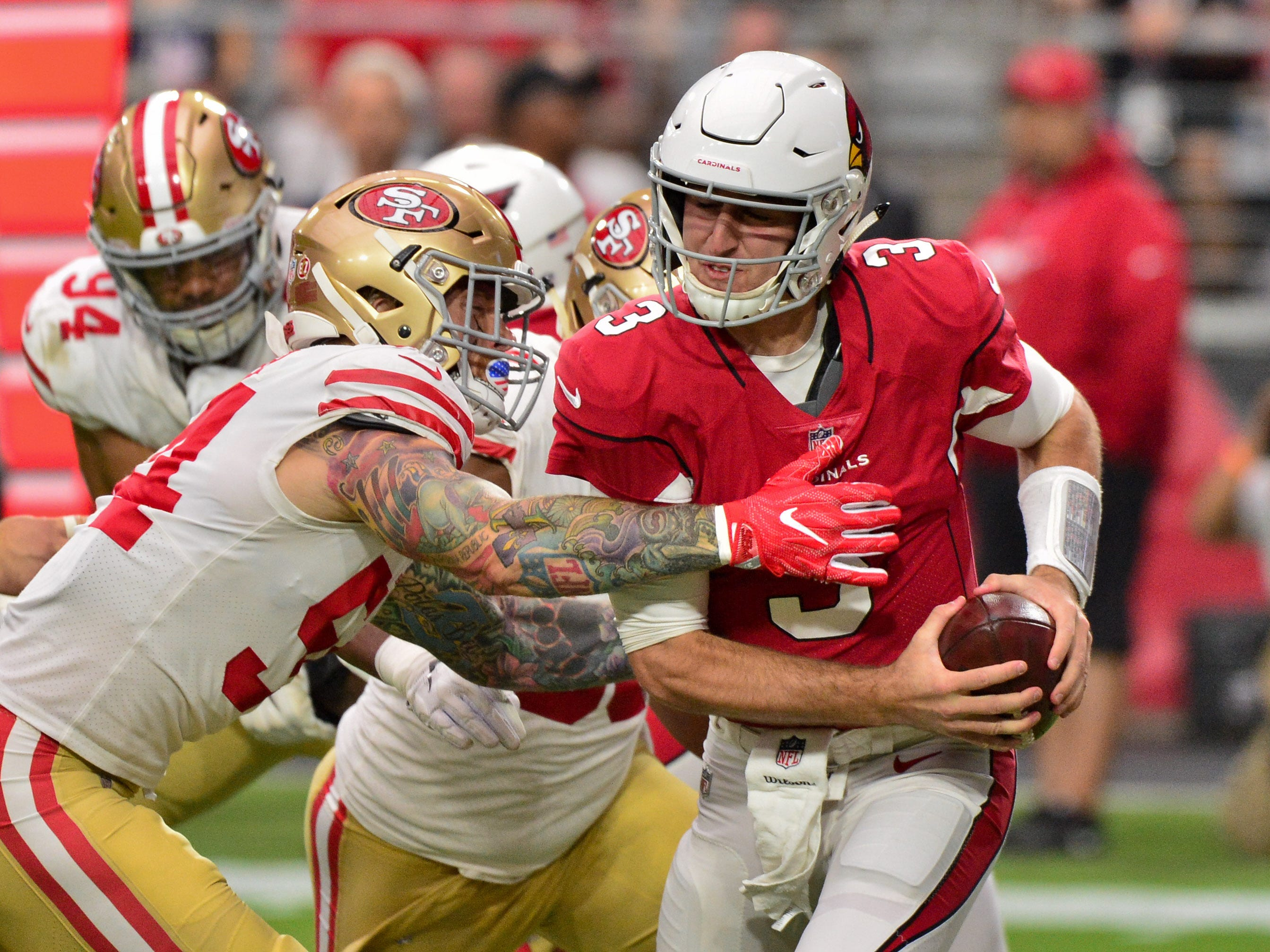 Oct 28, 2018; Glendale, AZ, USA; San Francisco 49ers defensive end Cassius Marsh (54) tackles Arizona Cardinals quarterback Josh Rosen (3) in the end zone resulting in a safety during the first half at State Farm Stadium.