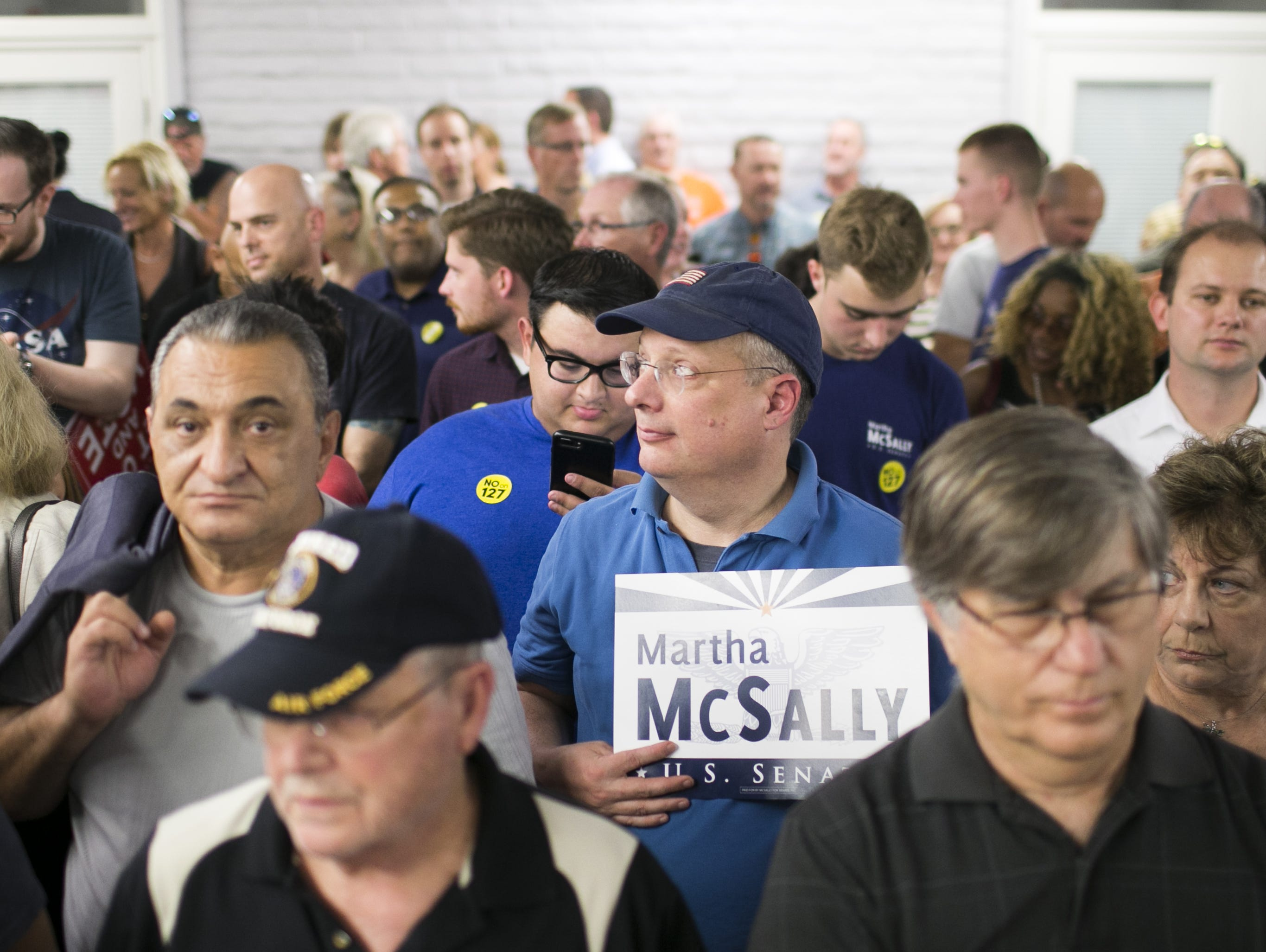 Republican supporters wait to see U.S. Senate candidate Martha McSally and Sen. Lindsey Graham, R-S.C. speak at the Arizona GOP headquarters in Phoenix, Ariz. on Oct. 27, 2018.