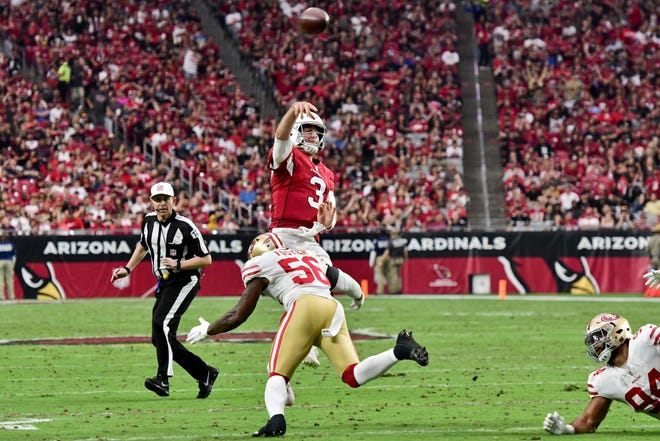 Oct 28, 2018; Glendale, AZ, USA; Arizona Cardinals quarterback Josh Rosen (3) throws while under pressure from San Francisco 49ers linebacker Reuben Foster (56) during the first half at State Farm Stadium.