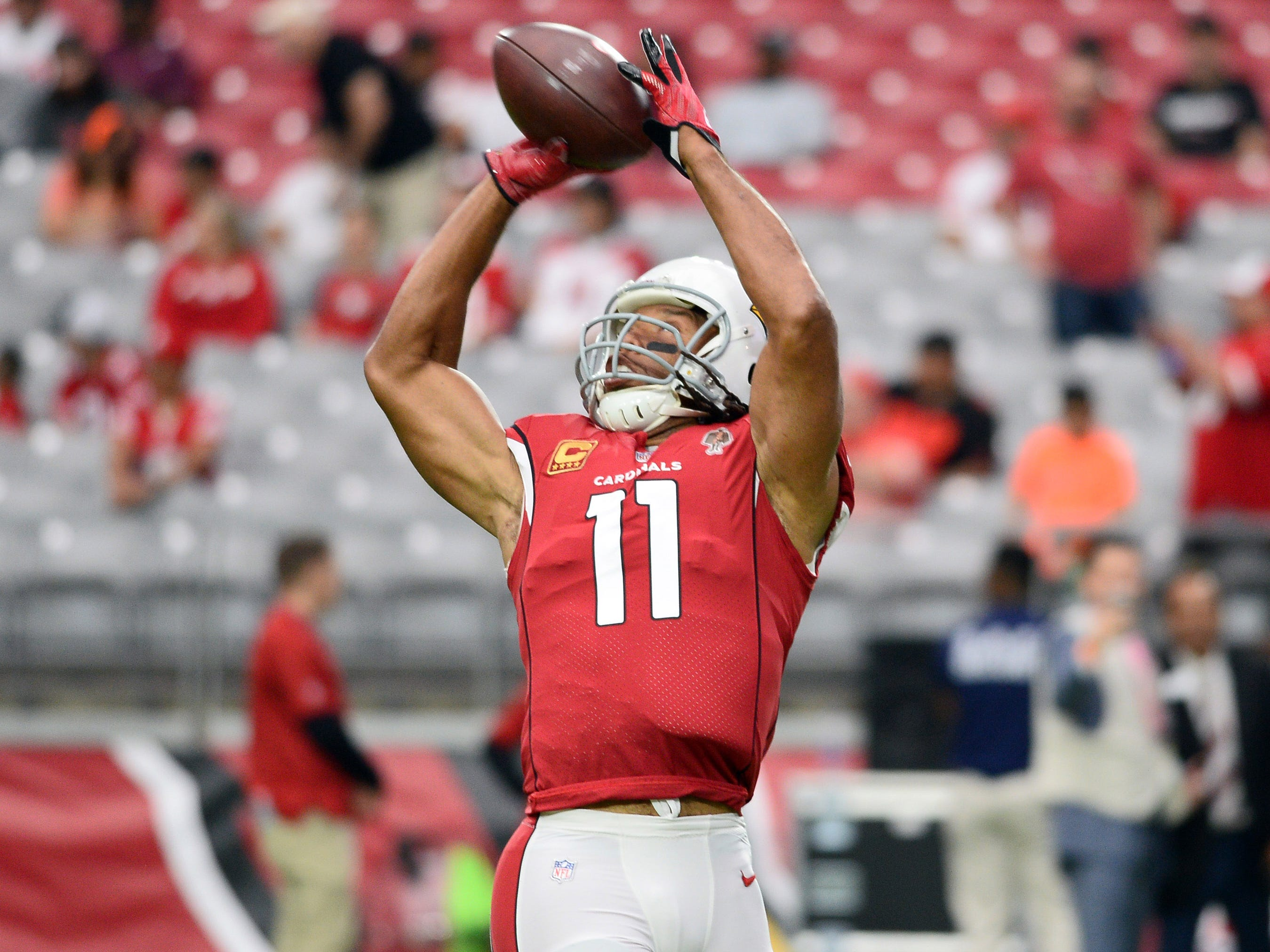 Oct 28, 2018; Glendale, AZ, USA; Arizona Cardinals wide receiver Larry Fitzgerald (11) warms up prior to facing the San Francisco 49ers at State Farm Stadium.