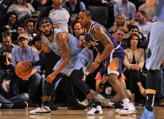 Oct 27, 2018; Memphis, TN, USA; Memphis Grizzlies guard Mike Conley (11) dribbles the ball as Phoenix Suns guard Isaiah Canaan (0) defends during the first half at FedExForum. Mandatory Credit: Justin Ford-USA TODAY Sports