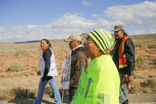 From left, Johannah Barber, Jerald Begay, Sarah Begay and Bobby Mason participate in an awareness walk organized by Walking the Healing Path on Oct. 18, 2018 along Navajo Route 13 in Red Valley, Ariz.