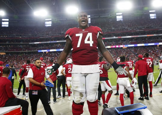 Arizona Cardinals offensive tackle D.J. Humphries (74) yells towards the fans after taking a 18-15 lead in the fourth quarter during NFL action against the San Francisco 49ers on Oct. 28 at State Farm Stadium.