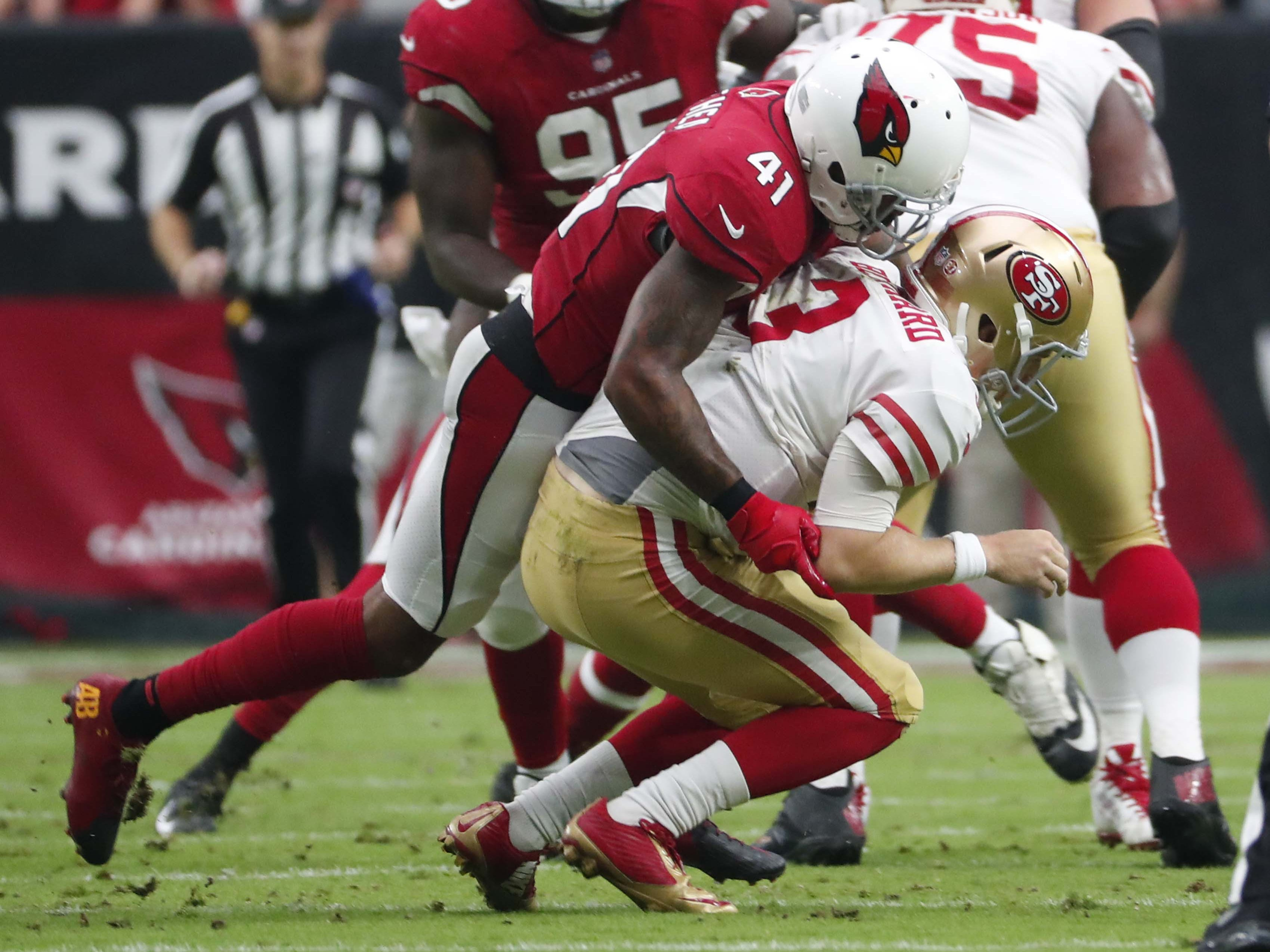 Arizona Cardinals free safety Antoine Bethea (41) sacks San Francisco 49ers quarterback C.J. Beathard (3) in the first quarter during NFL action against the San Francisco 49ers on Oct. 28 at State Farm Stadium.