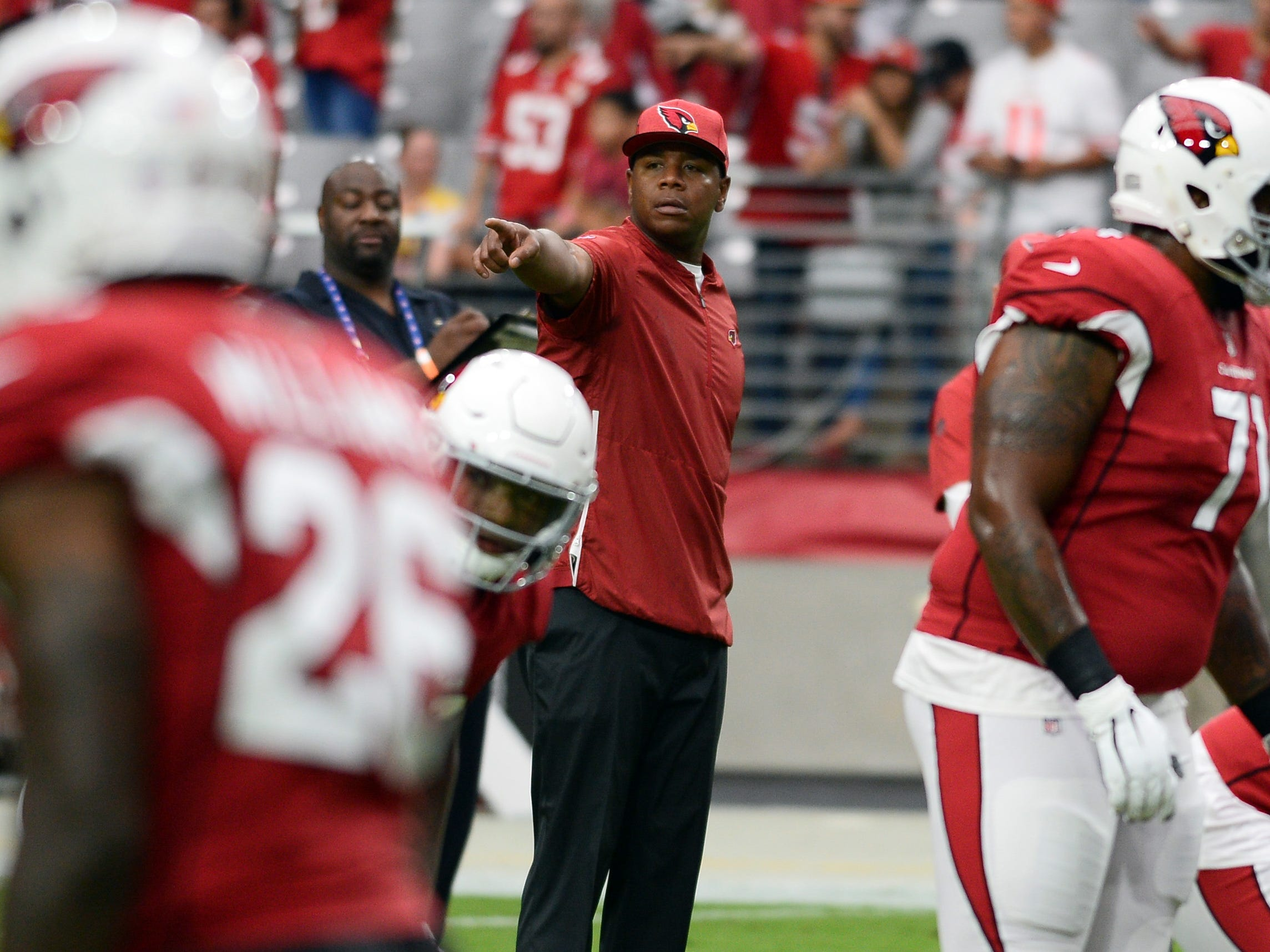 Oct 28, 2018; Glendale, AZ, USA; Arizona Cardinals offensive coordinator Byron Leftwich looks on during warmups prior to facing the San Francisco 49ers at State Farm Stadium.