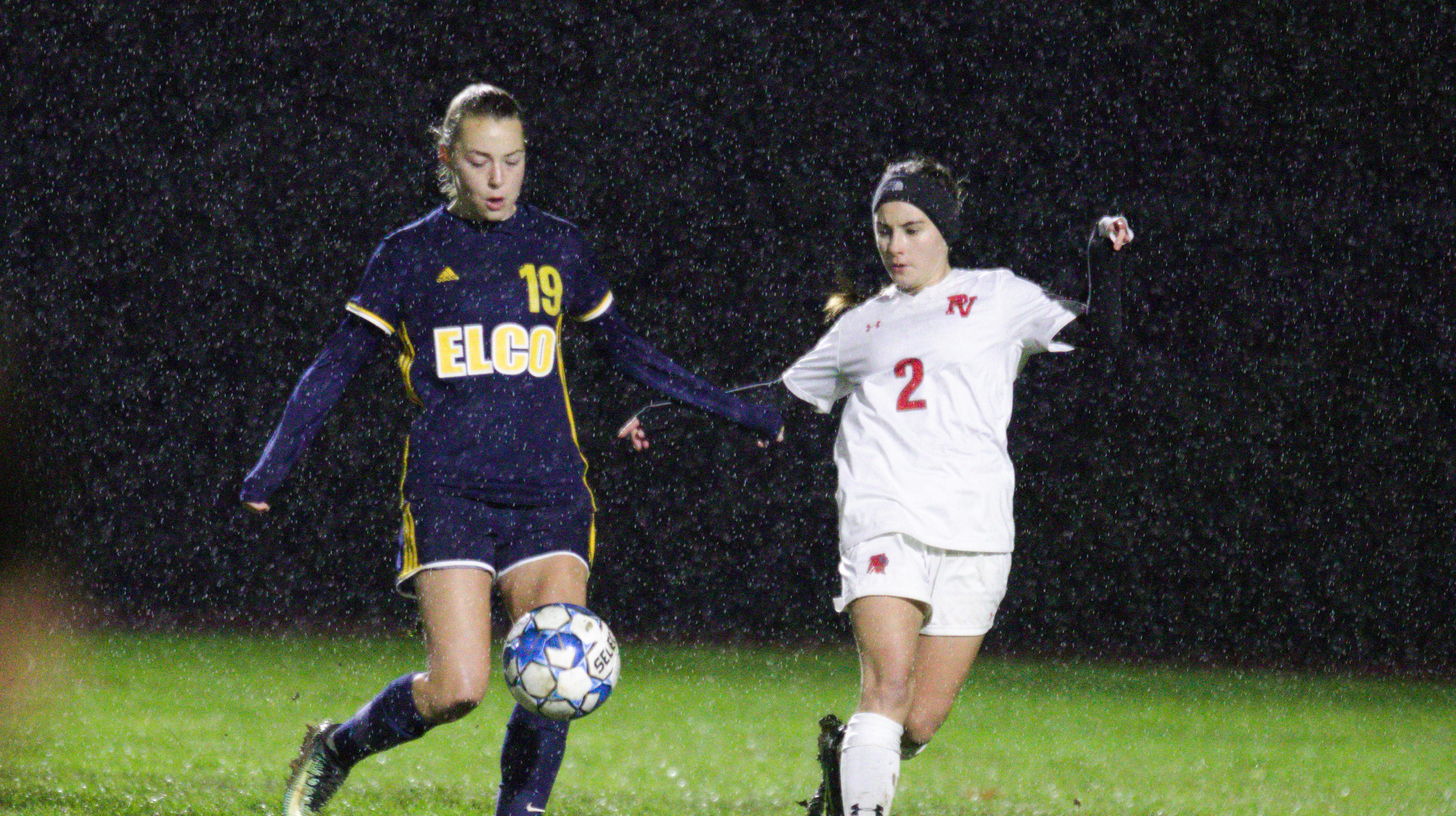 Elco's Natalie Swingholm keeps the ball away from a Pequea Valley defender during the Raiders' 7-0 district playoff win on Saturday night.