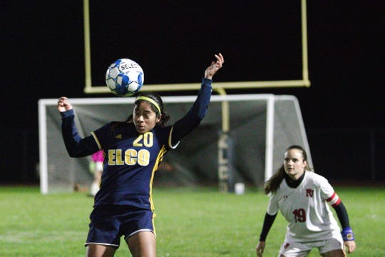 Elco's Tanisha Grewal heads the ball away from a Pequea Valley player.