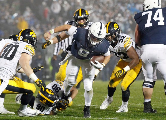 Penn State quarterback Trace McSorley (9) runs up the middle against Iowa during the second half of an NCAA college football game in State College, Pa., Saturday, Oct. 27, 2018. Penn State won 30-24. (AP Photo/Chris Knight)