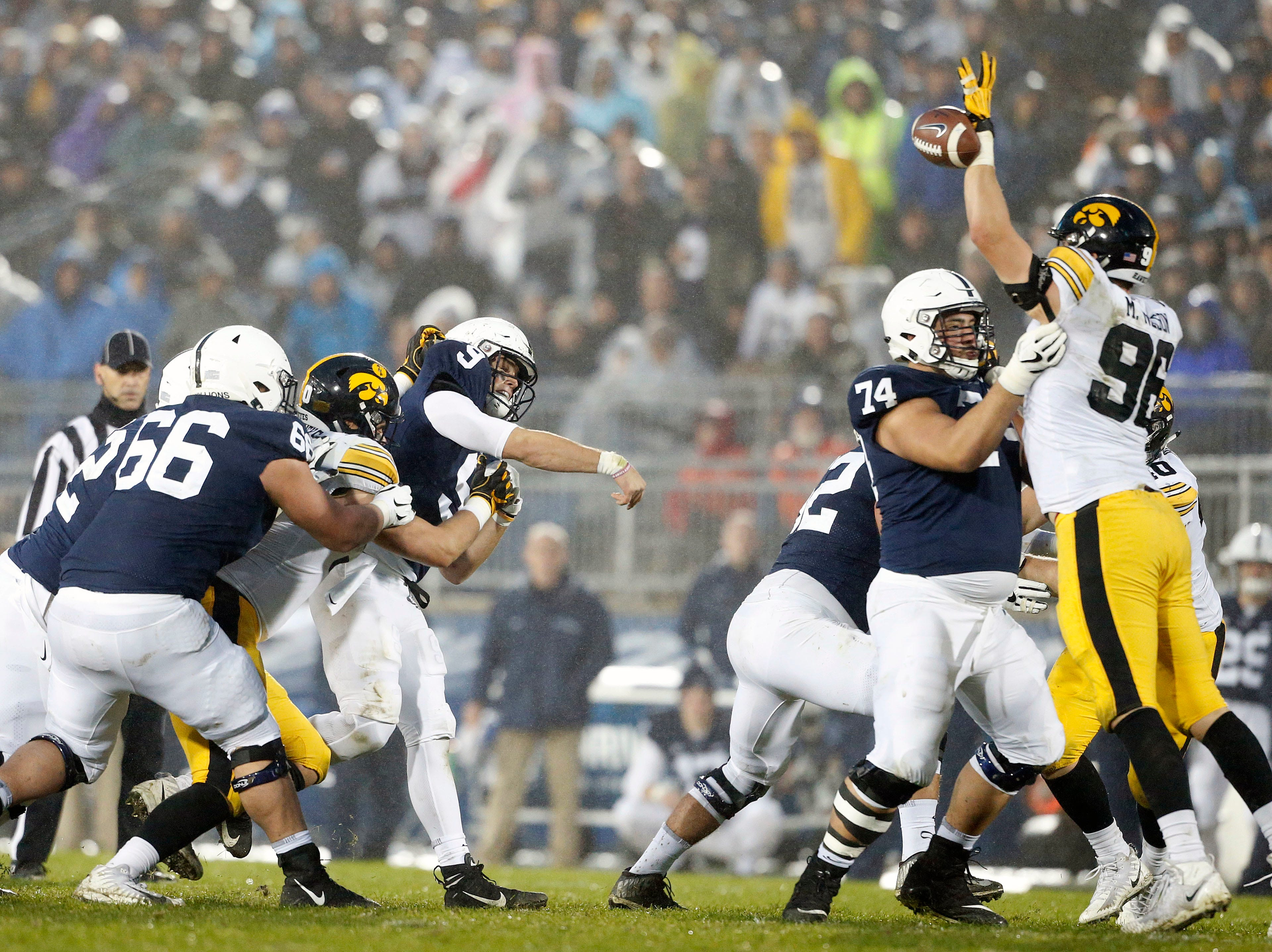 Penn State quarterback Trace McSorley (9) has his pass knocked down by Iowa's Matt Nelson (96) during the second half of an NCAA college football game in State College, Pa., Saturday, Oct. 27, 2018. (AP Photo/Chris Knight)