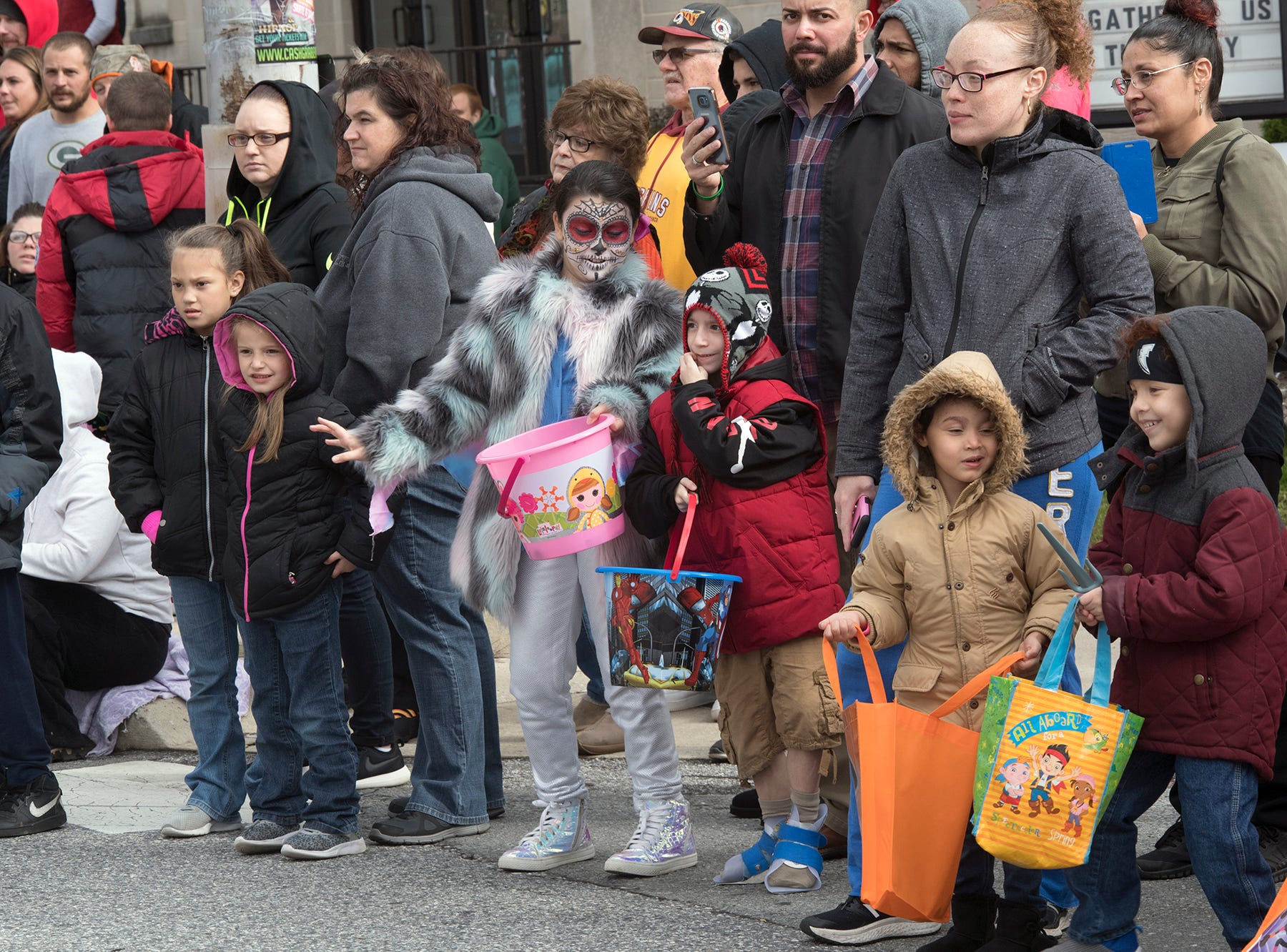 Children wait for candy during the 69th Annual York Halloween Parade.
