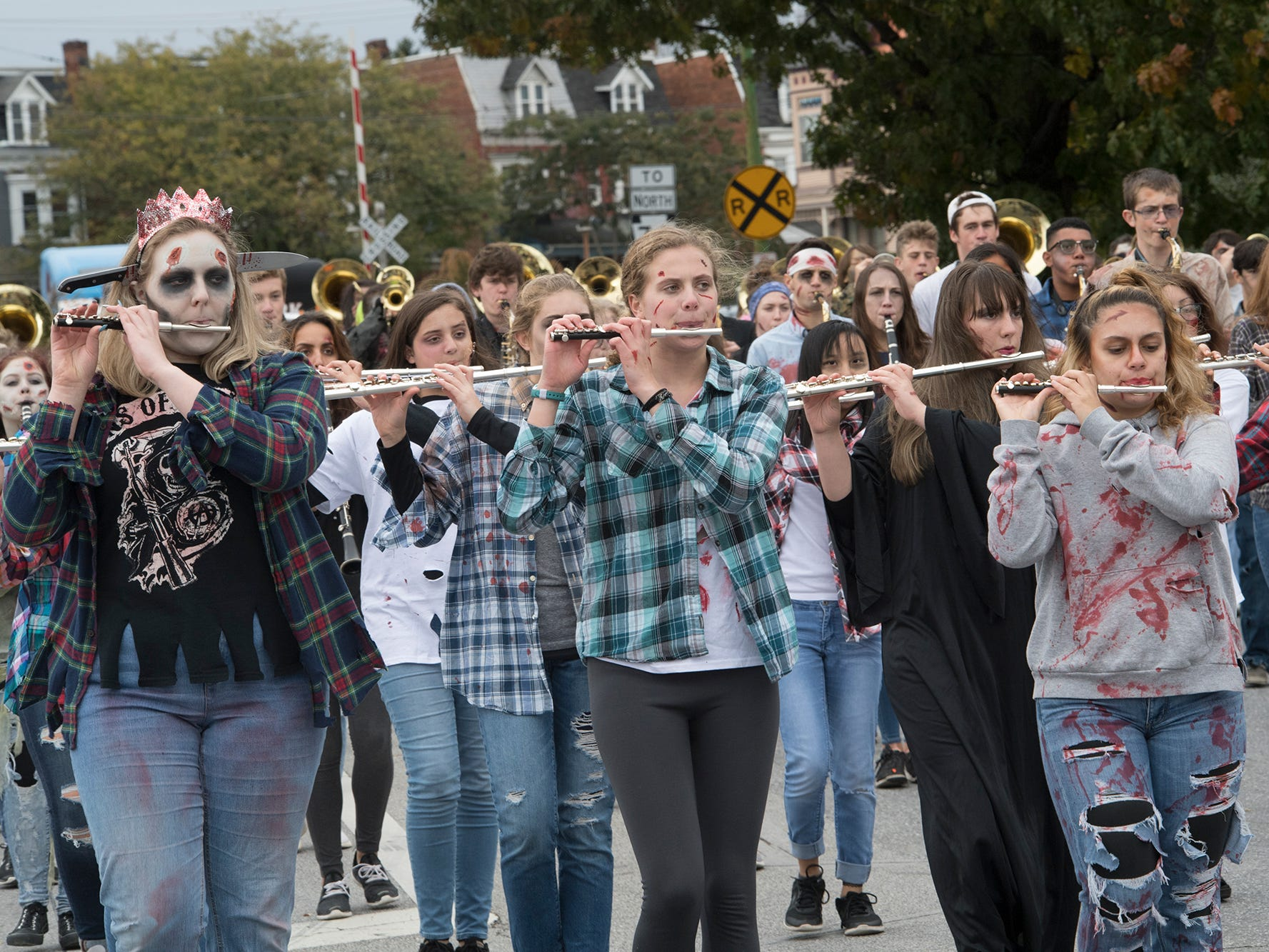 Central York Marching Zombies march during the 69th Annual York Halloween Parade presented by York Traditions Bank Sunday.