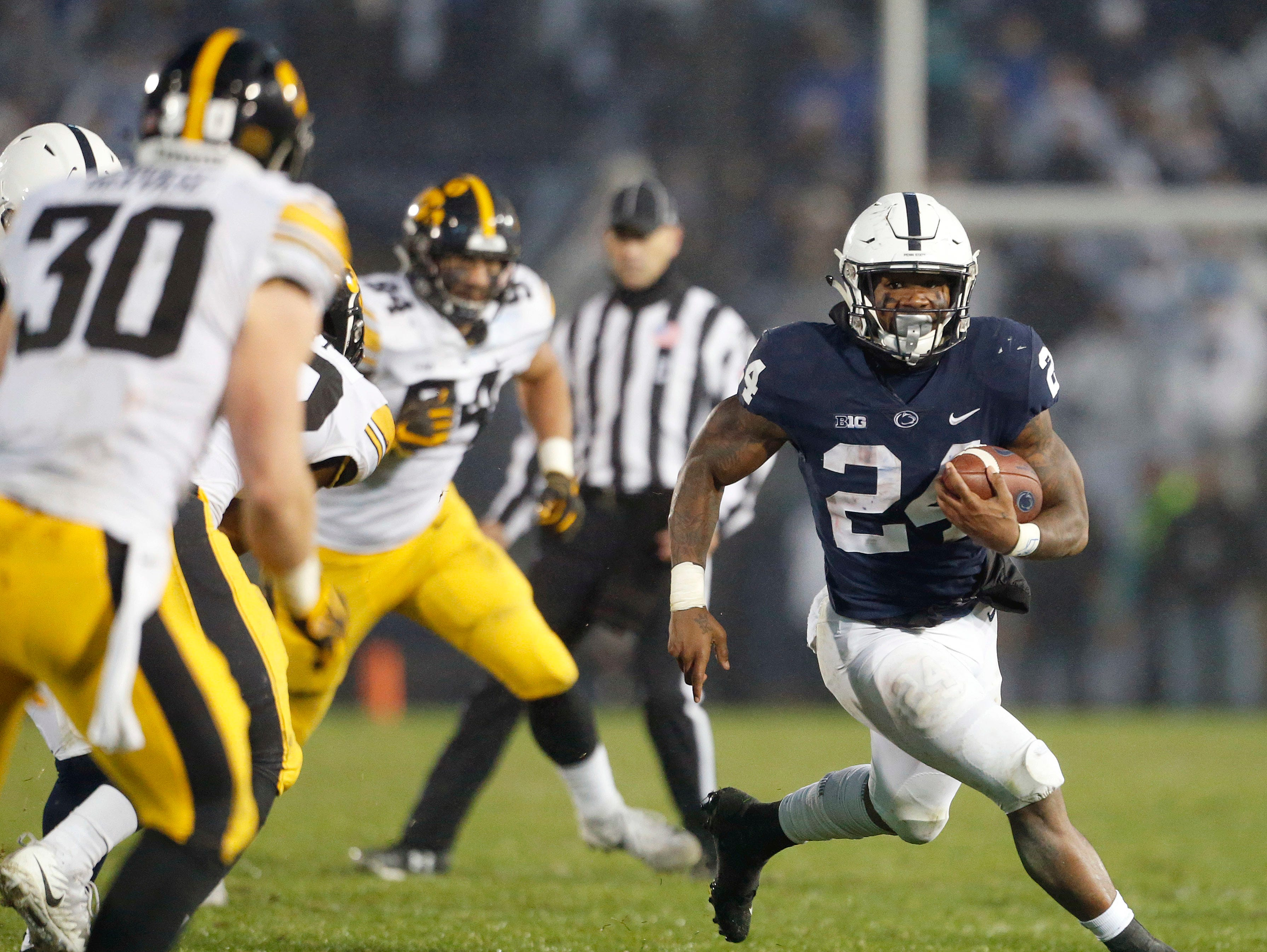 Penn State's Miles Sanders (24) runs the ball against Iowa during the second half of an NCAA college football game in State College, Pa., Saturday, Oct. 27, 2018. Penn State won 30-24. (AP Photo/Chris Knight)