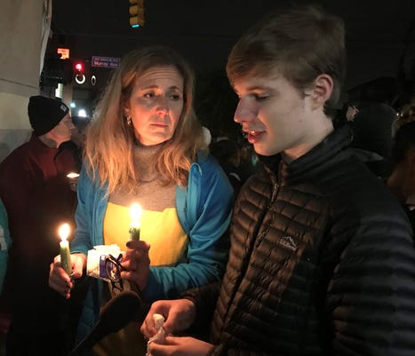 (left) Amanda Godlay, 48 and Joseph Creiman, 17 speak with members of the press during the candlelight vigil Saturday, October 27 in Pittsburgh, PA.