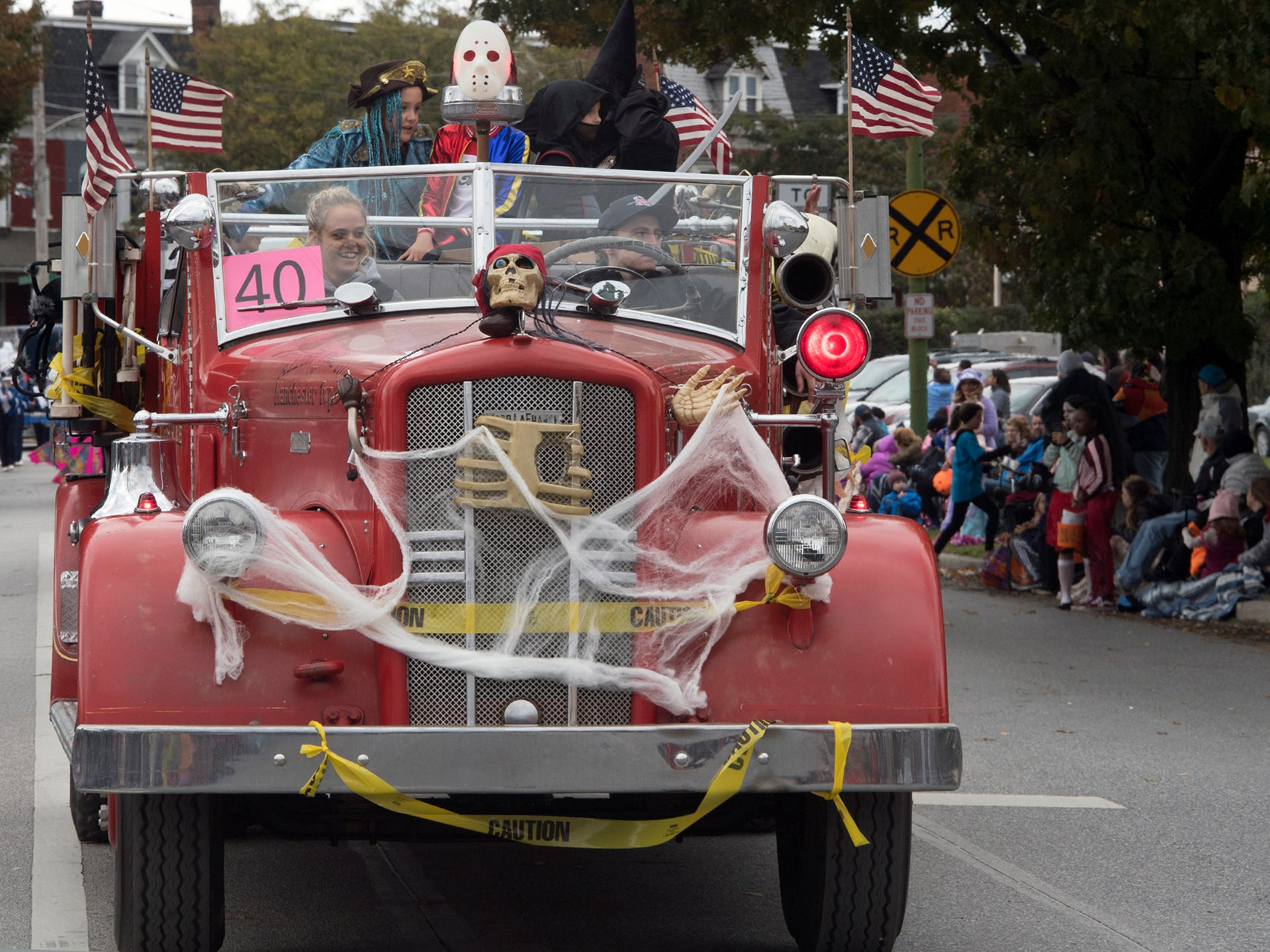 An antique Emigsville engine works it's way east during the 69th Annual York Halloween Parade.
